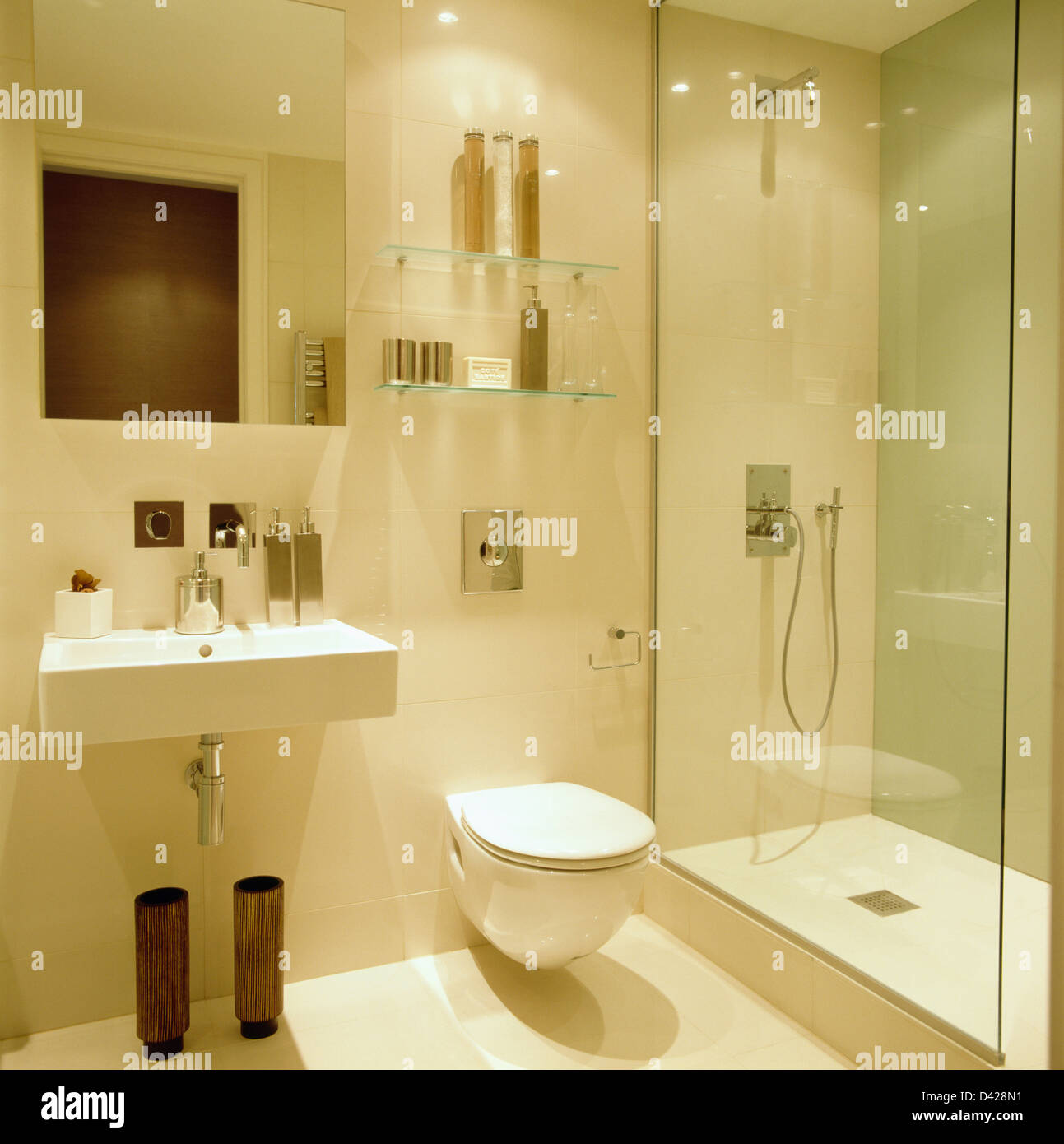 Wall Mounted Basin And Glass Shower Cabinet In Modern White Bathroom With Shelves Above Toilet