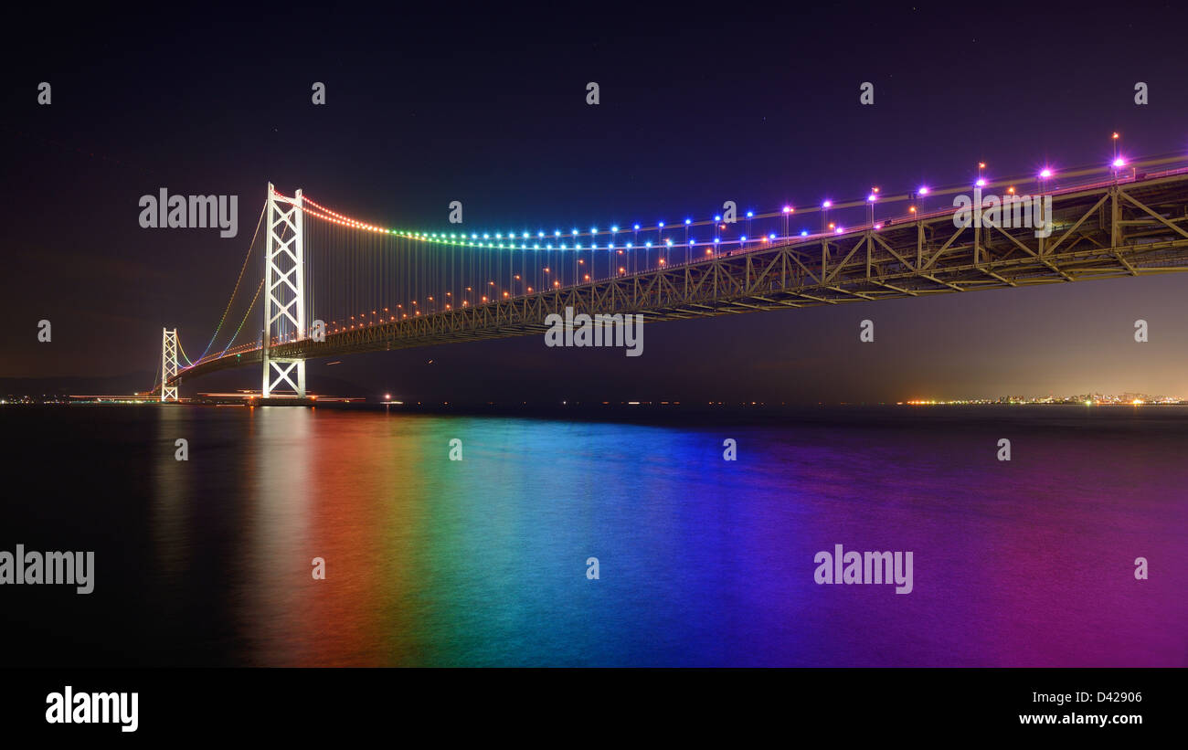 Rainbow lights on Akashi Ohashi (Pearl Bridge) in Kobe, Japan. - Stock Image