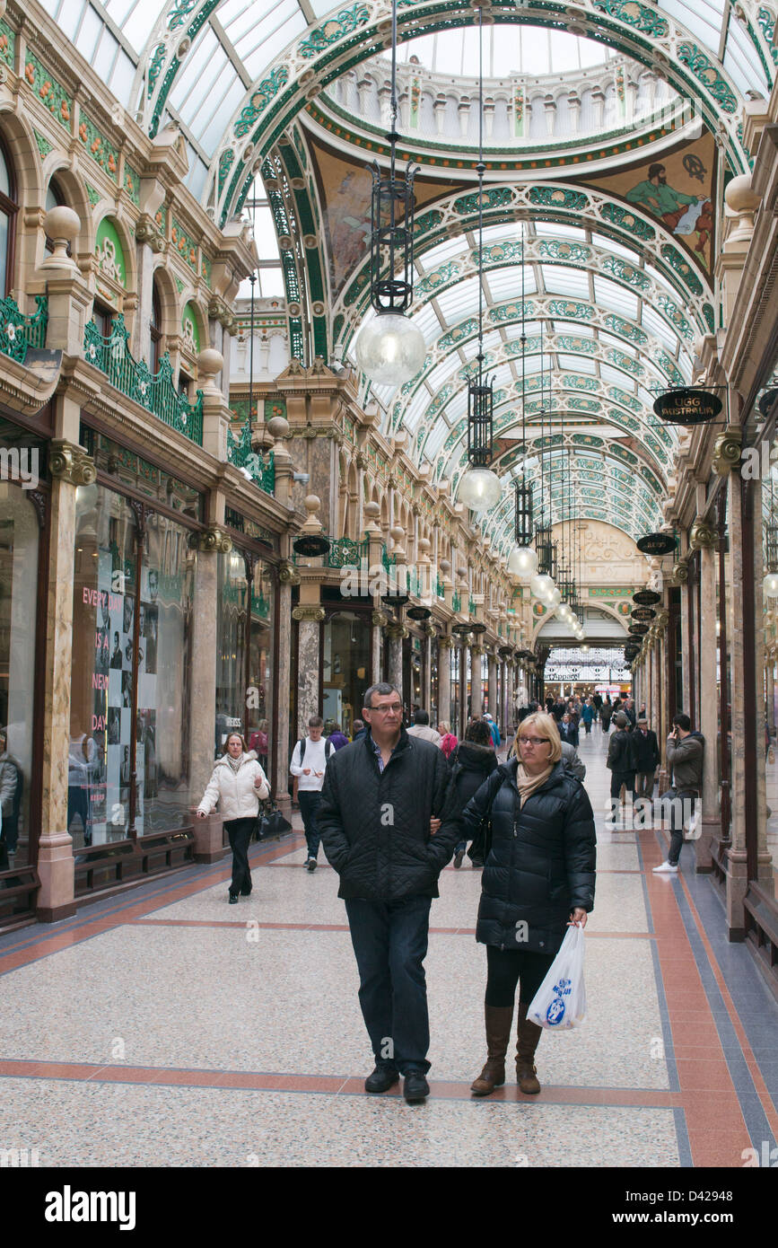 Couple walking through County Arcade Leeds, England UK - Stock Image