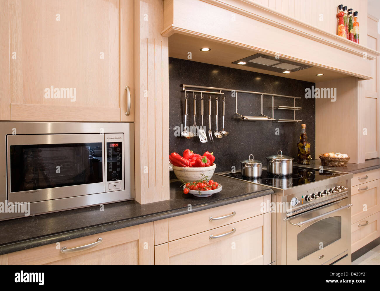 built in microwave in modern spanish kitchen with chrome utensils on stock photo 54141446 alamy. Black Bedroom Furniture Sets. Home Design Ideas