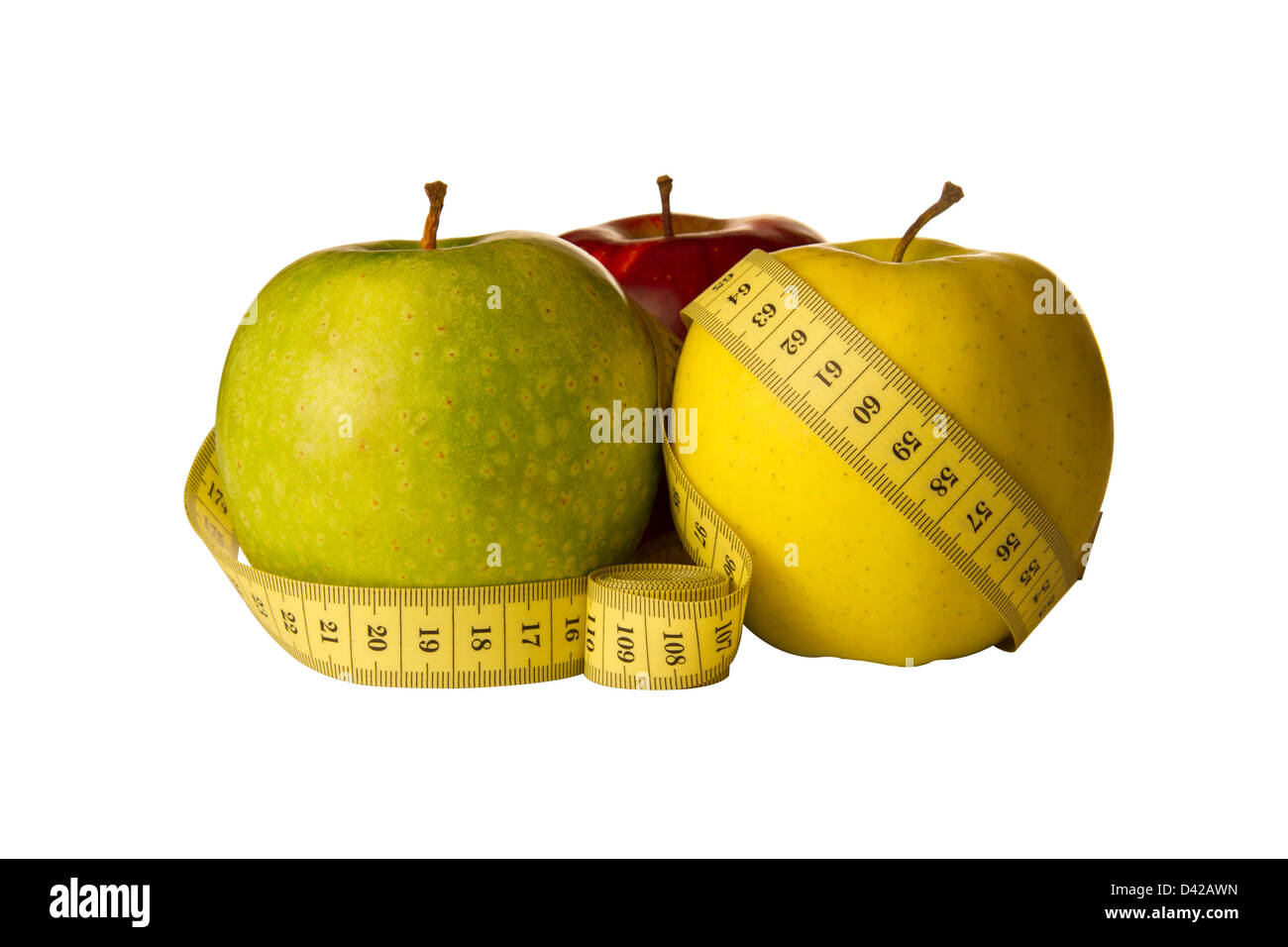 three apples and meter on a white background - Stock Image