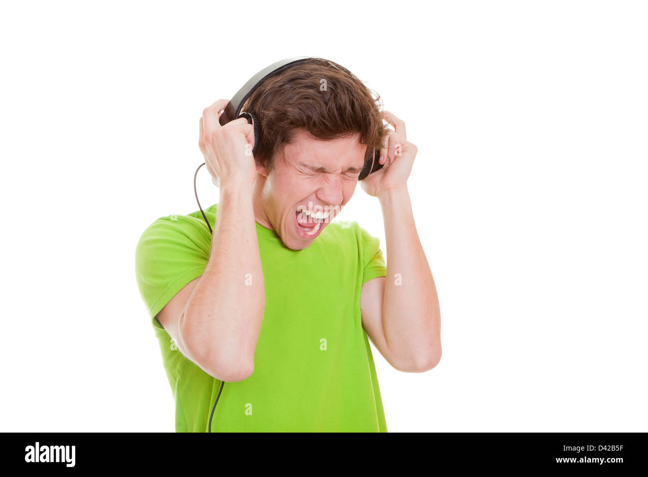 teen singing, listening to music with headphones Stock Photo