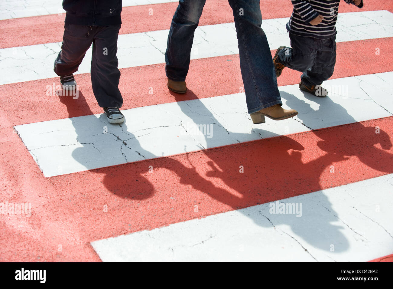 Luino, Italy, people walking over the zebra crossing in Luino Stock Photo
