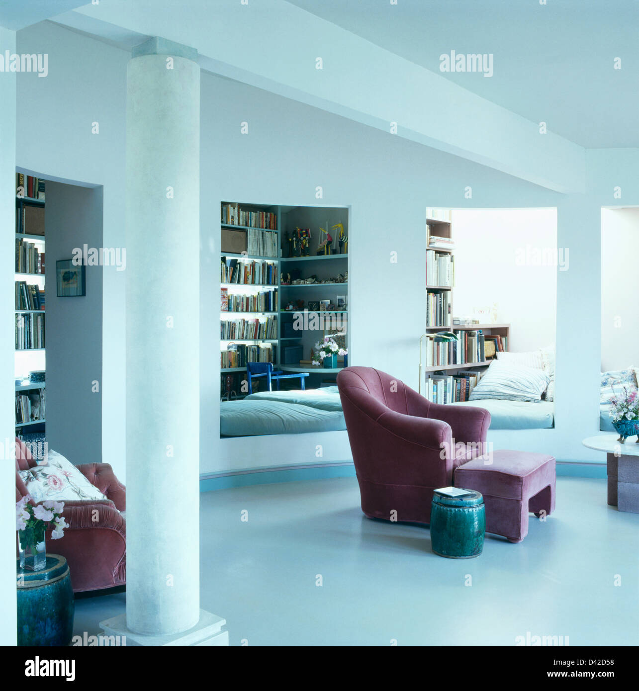Picture of: Pink Velvet Armchair And Footstool In Open Plan Modern Living Room Stock Photo Alamy