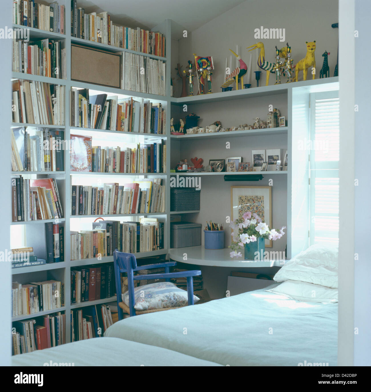 Wall Of Bookshelves In Small Modern Bedroom Designed By Yudell Beebe