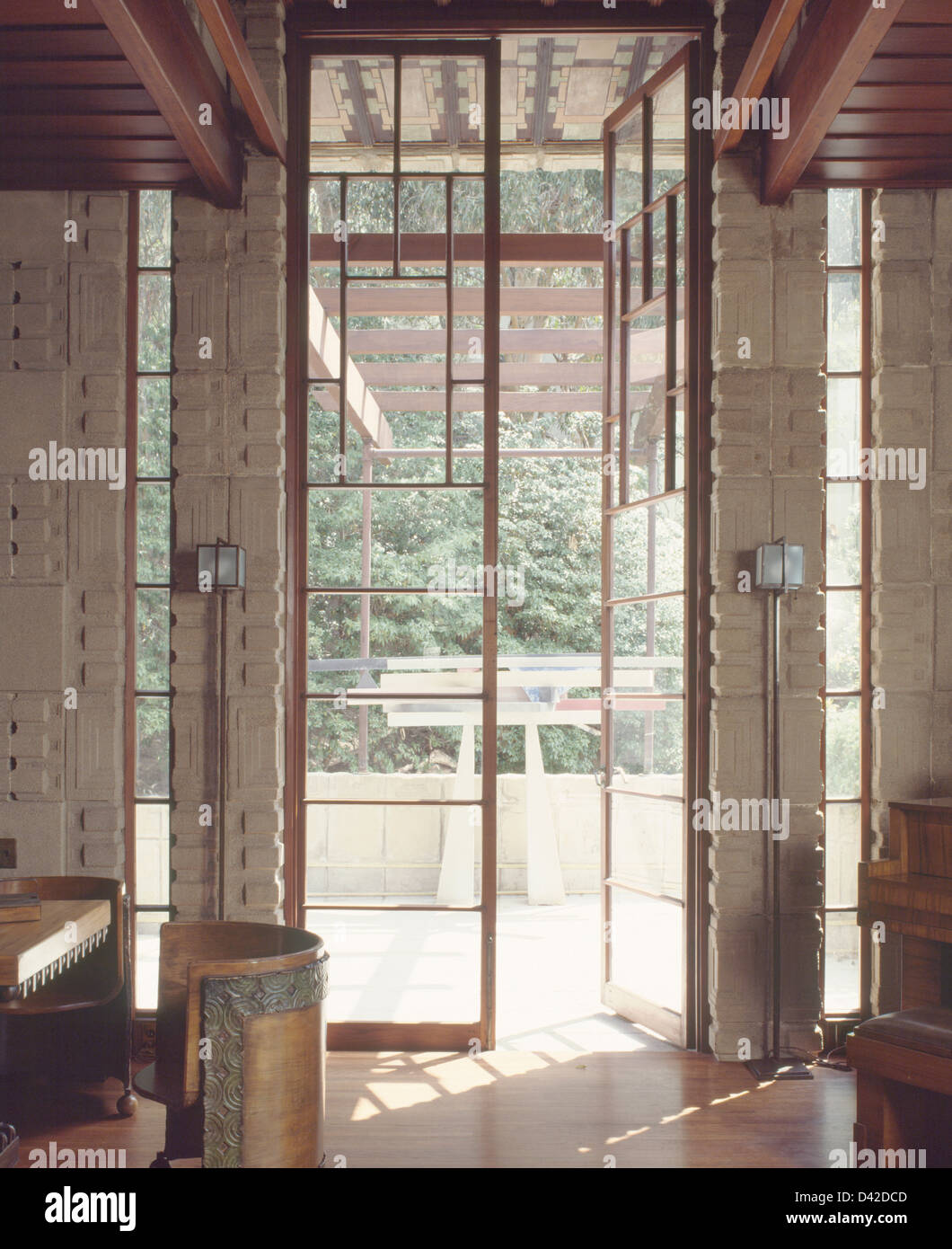 Tall glass doors in hall of the Storer House designed by Frank Lloyd Wright in 1923 & Tall glass doors in hall of the Storer House designed by Frank Lloyd ...