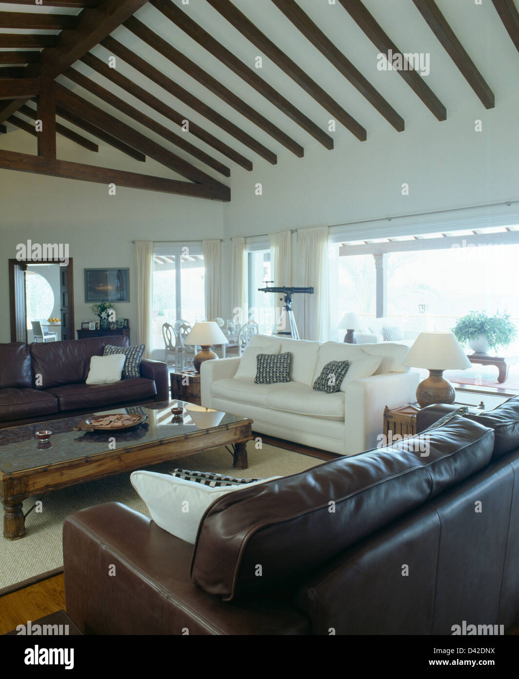 Brown leather sofas and white sofa in modern coastal living ...