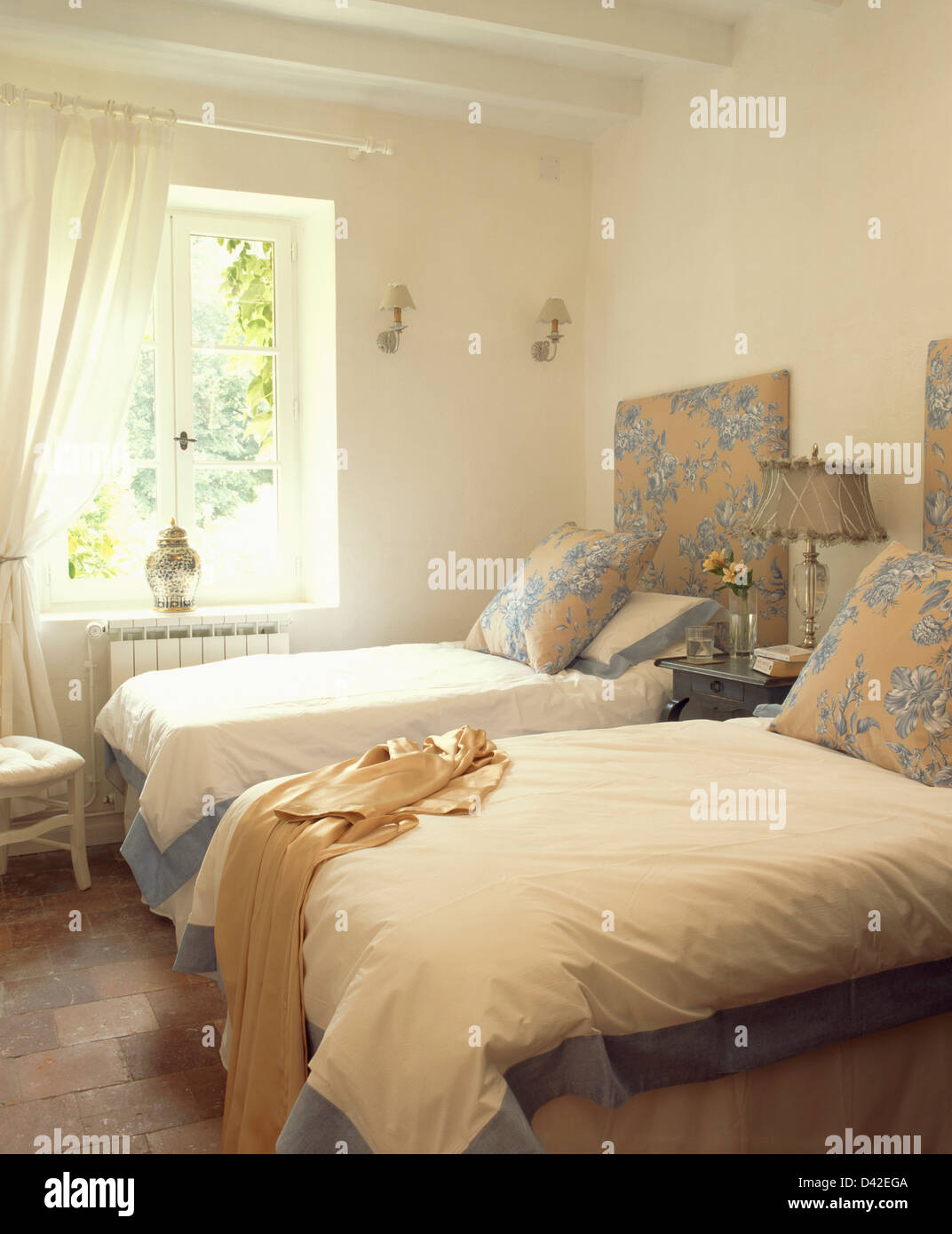 Picture of: Blue Cream Patterned Cushions And Headboards On Twin Beds With Stock Photo Alamy