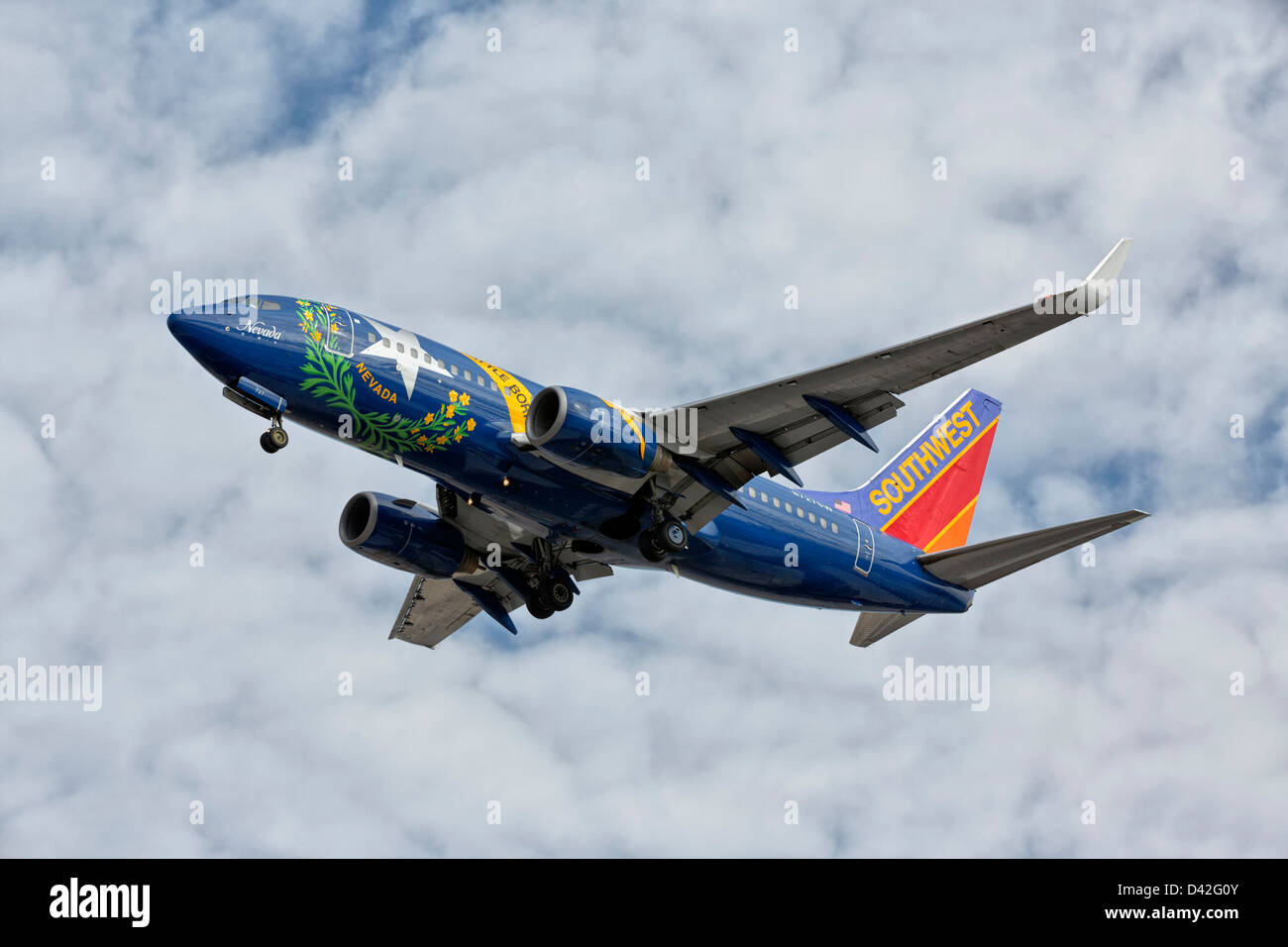 A Boeing 737 of Southwest airlines on final approach - Special Nevada state paint scheme - Stock Image