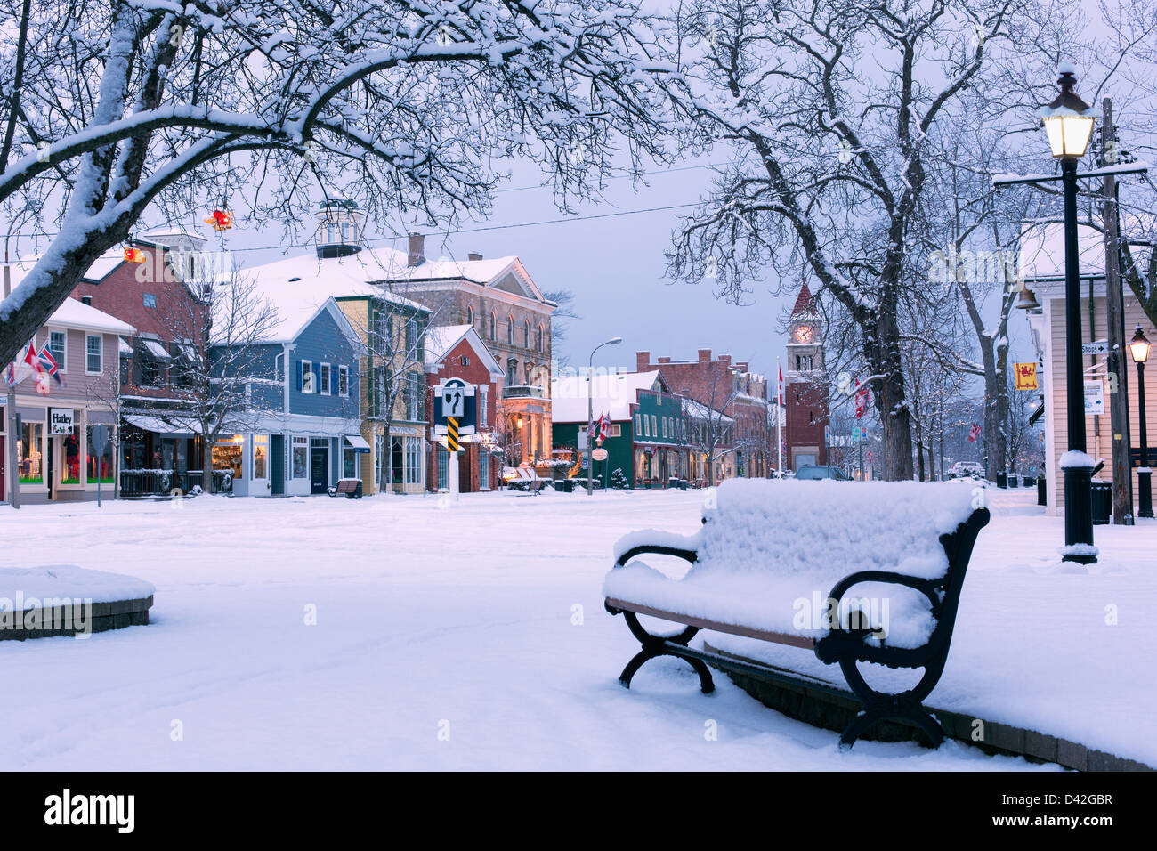 Canada,Ontario,Niagara-on-the-Lake,Queen Street, early winter morning, park bench covered in snow showing a main Stock Photo