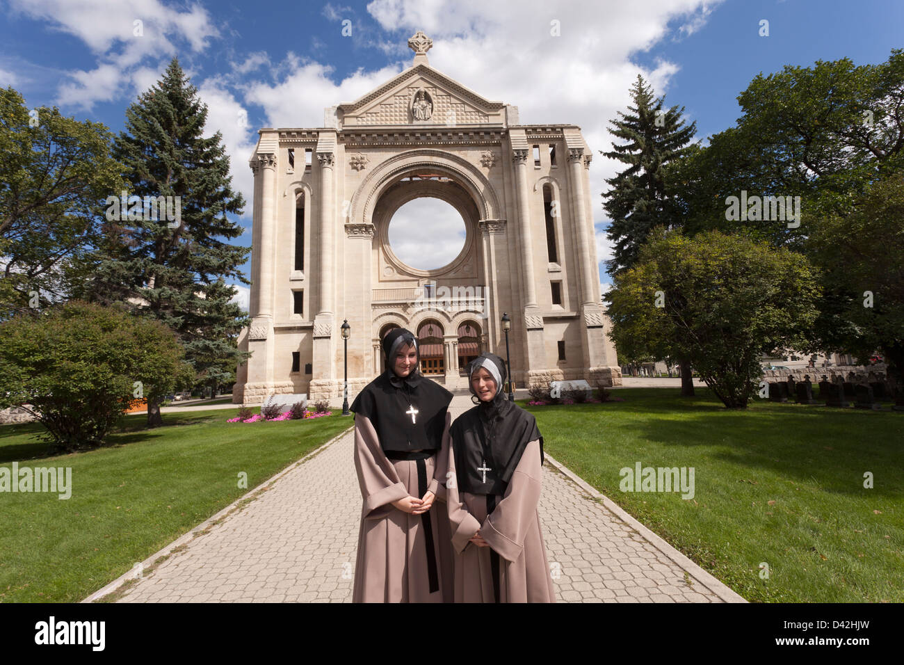 Canada,Manitoba,Winnipeg,Saint Boniface Cathedral, with two re-enactors portraying nuns - Stock Image