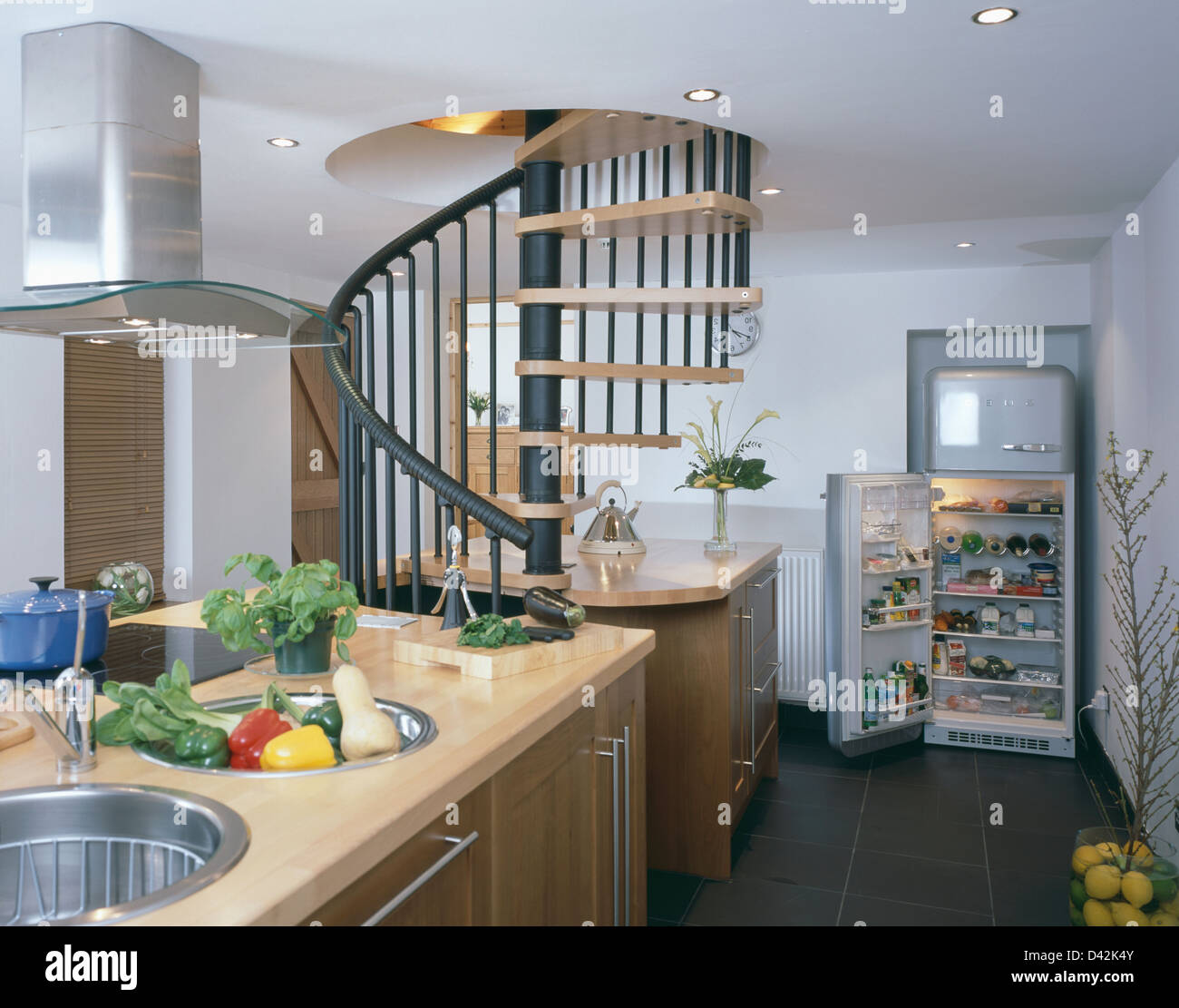 Superb Double Stainless Steel Sinks In Island Unit In Basement Kitchen With Spiral  Staircase And Smeg Fridge With Door Open