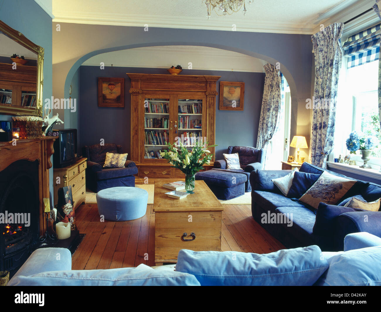 Pale blue and dark blue sofas and pine chest in pale blue ...