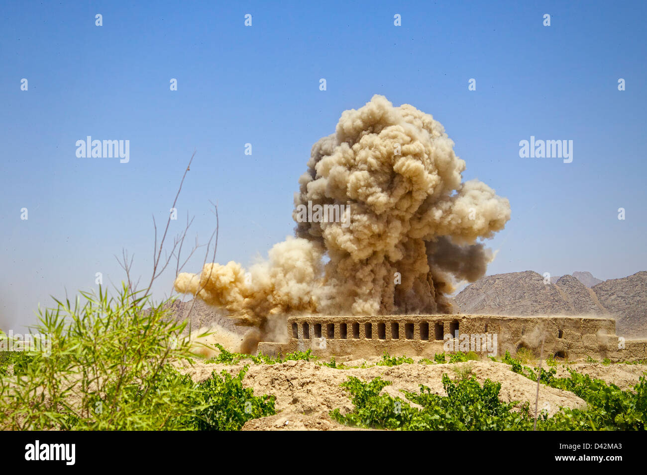 International Security Assistance Force soldiers detonate a set of Improvised Explosive Devices found along a path. - Stock Image