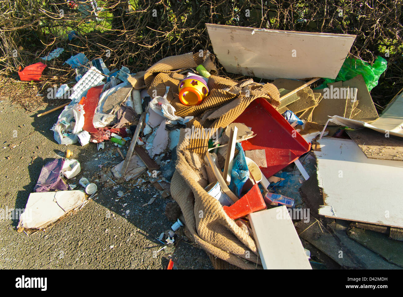 Fly tipped household rubbish in a green lane / bridleway, South Yorkshire, England. - Stock Image