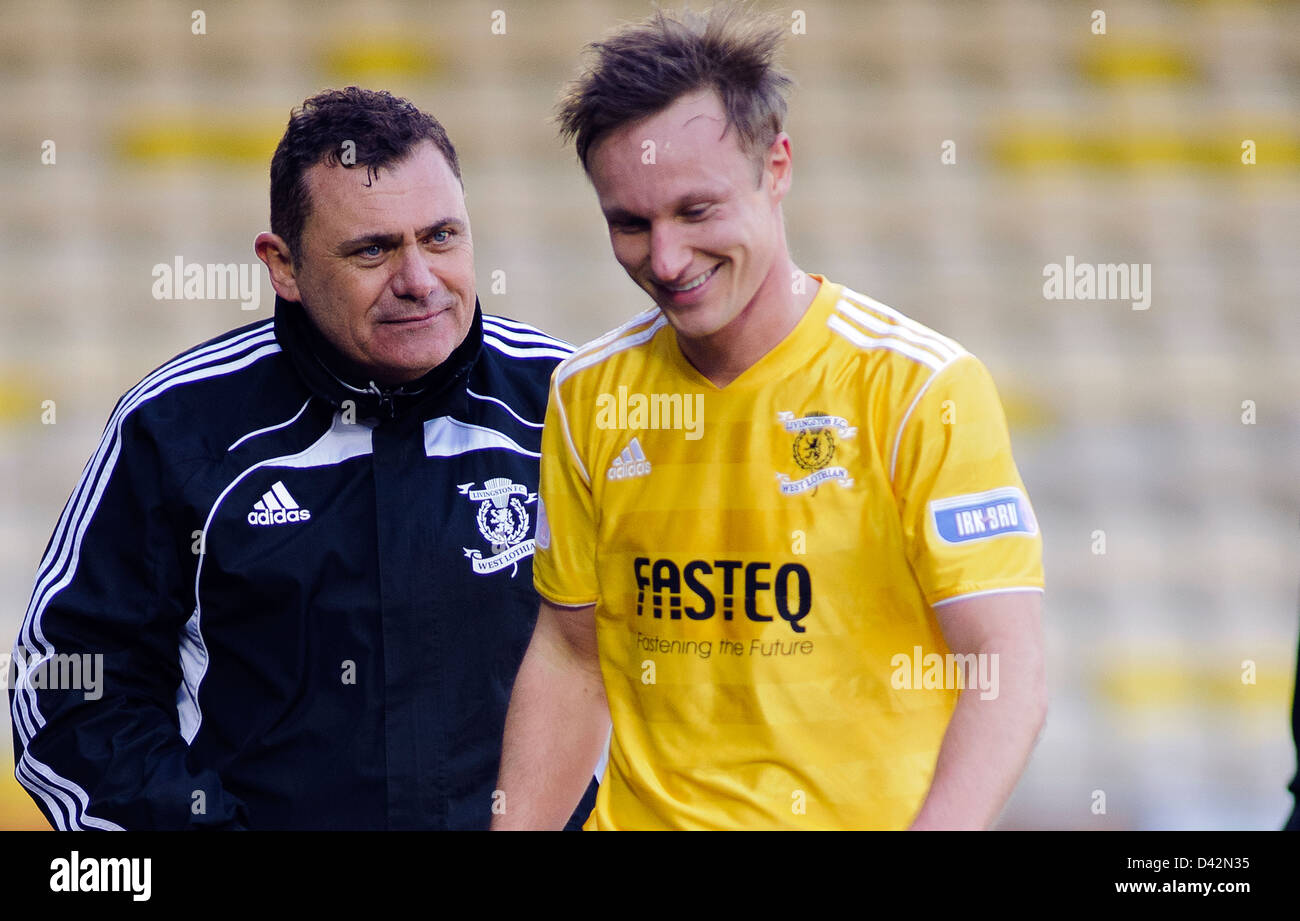 Livingston caretaker Manager Ritchie Burke with Iain Russell - Stock Image