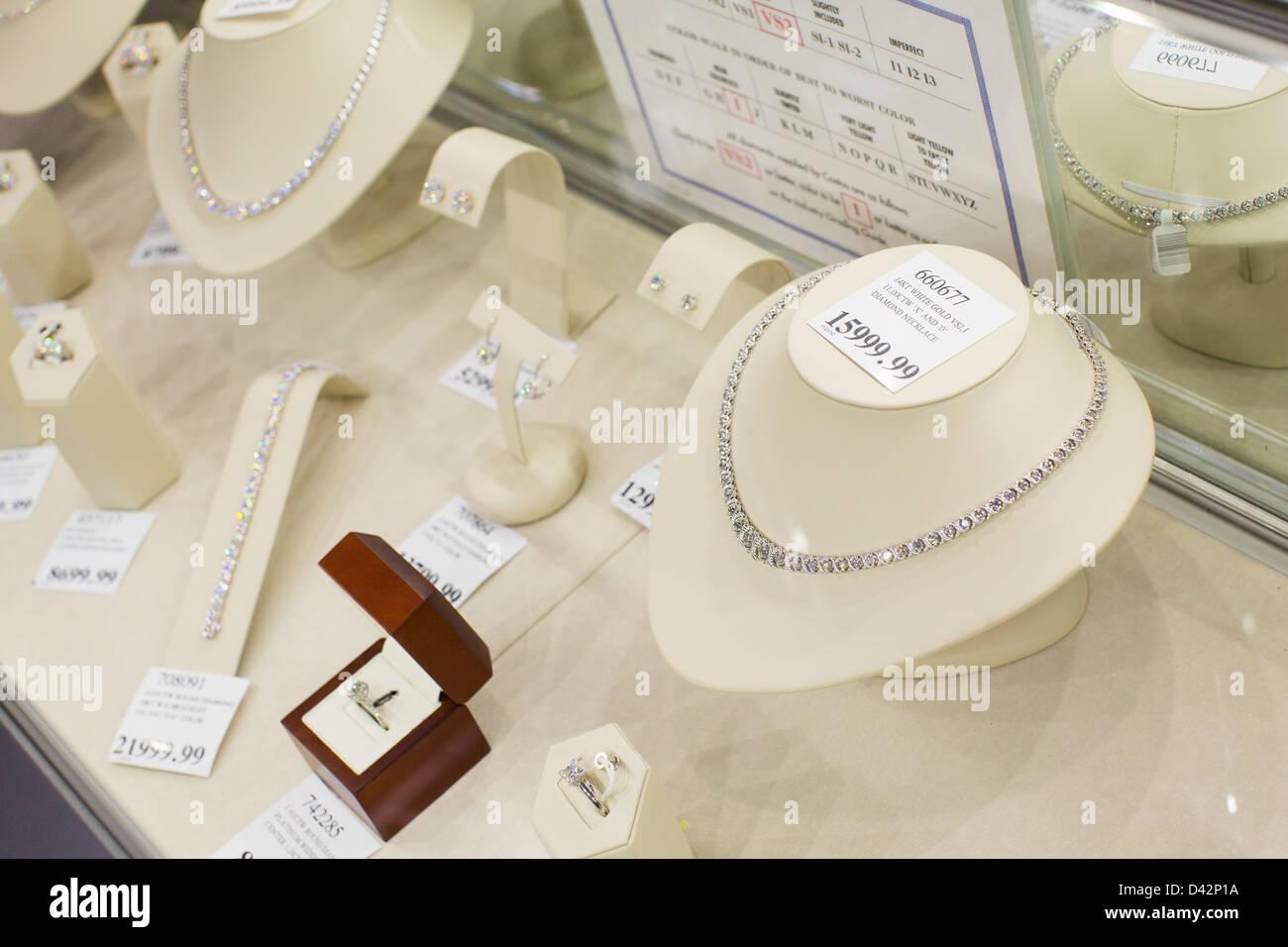 Diamond jewelry on display at a Costco Wholesale Warehouse Club. - Stock Image