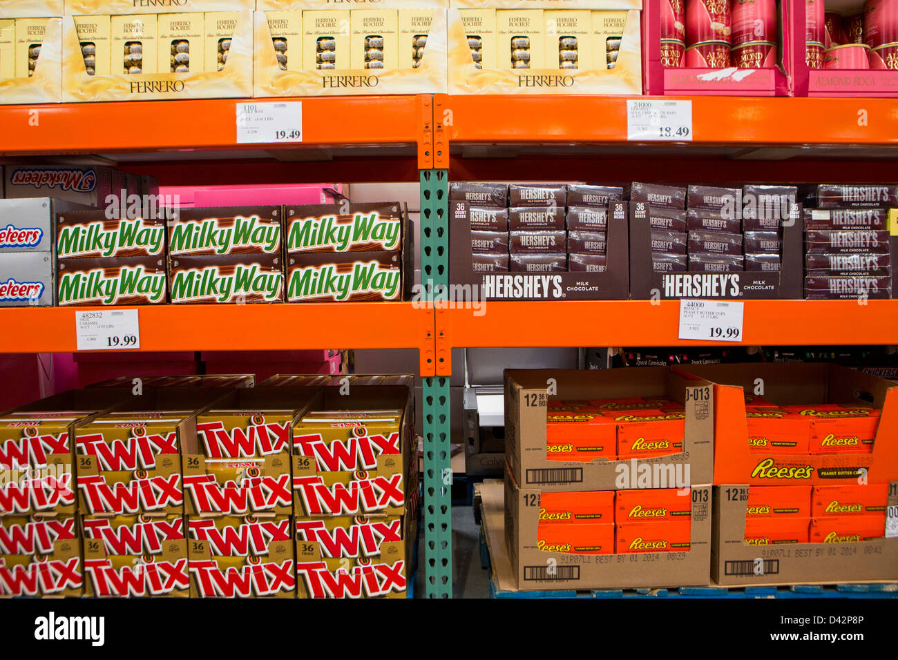 Milky Way, Reese's Peanut Butter Cups, Twix and Hershey's bars on display at a Costco Wholesale Warehouse - Stock Image