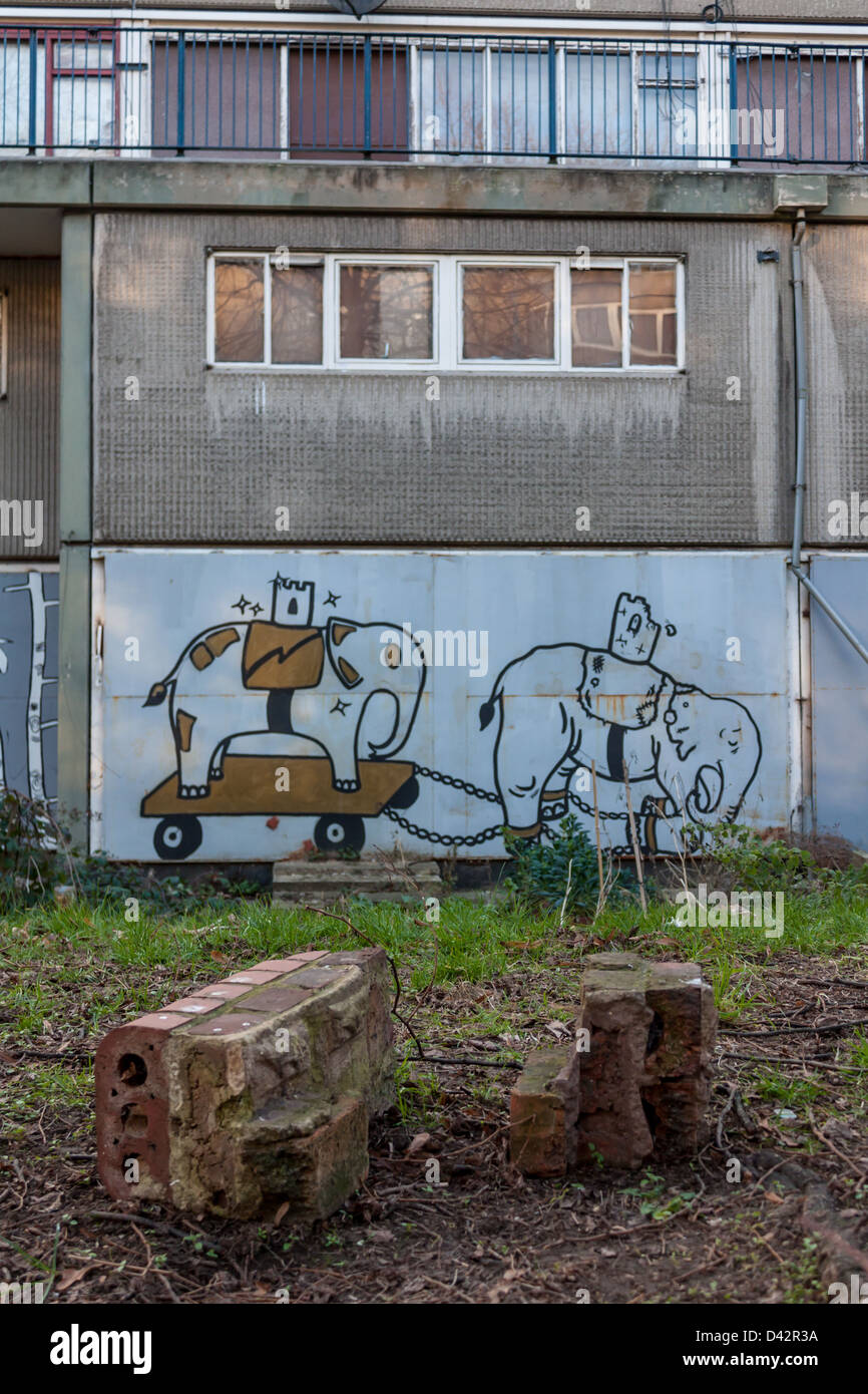 Street art on the condemned buildings of the Heygate Estate. bemoaning the regeneration process - Stock Image
