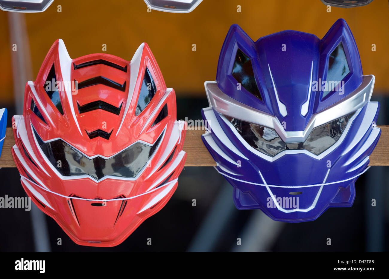 Children's plastic super hero masks in bright colors for sale at a festival stand in Japan. - Stock Image