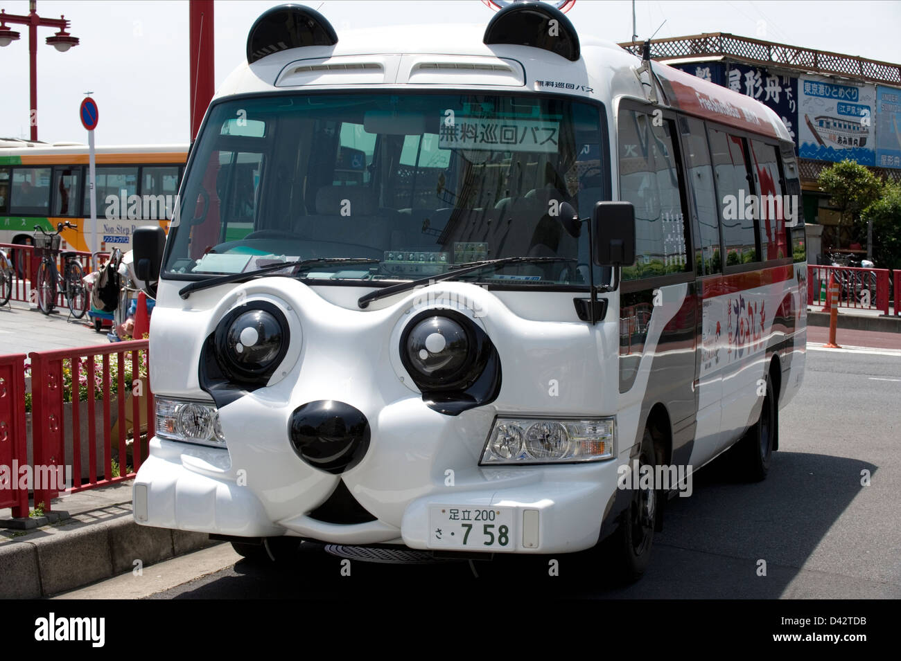 A free shuttle bus in the shape of a panda bear takes tourists around Tokyo sightseeing spots. - Stock Image