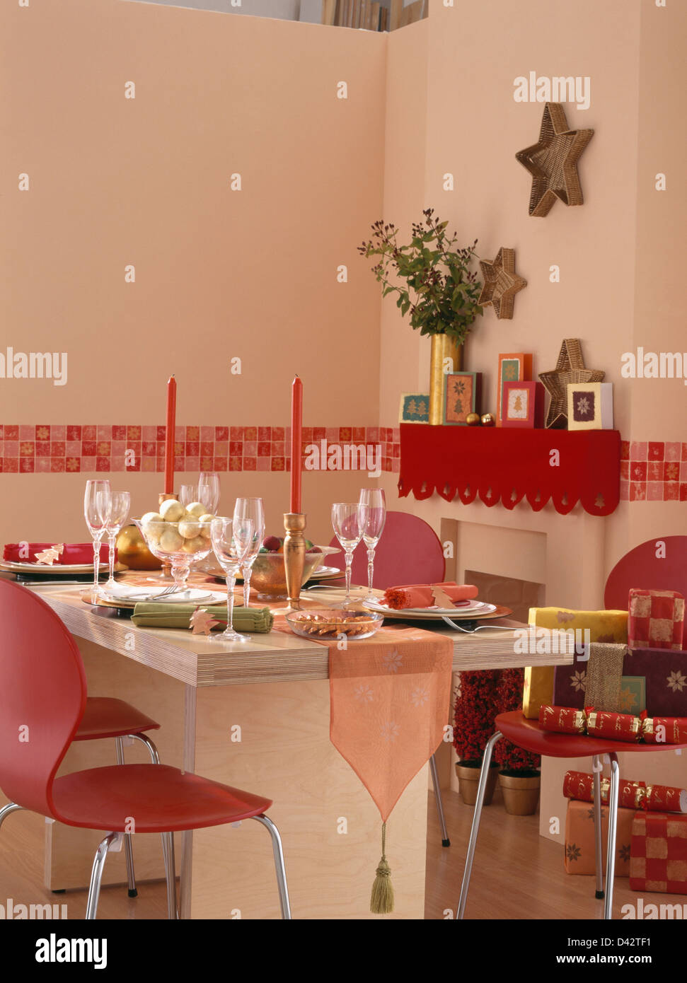 Red Chairs At Simple Table Set For Christmas Dinner In Economy Style Stock Photo Alamy
