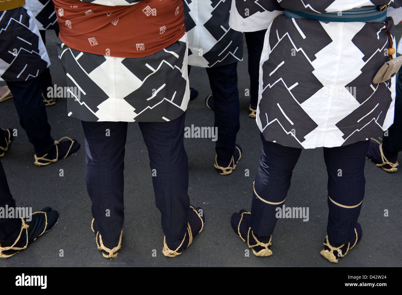 Detail of Sanja Matsuri Festival participants in Asakusa, Tokyo wearing traditional happi coats and waraji straw - Stock Image