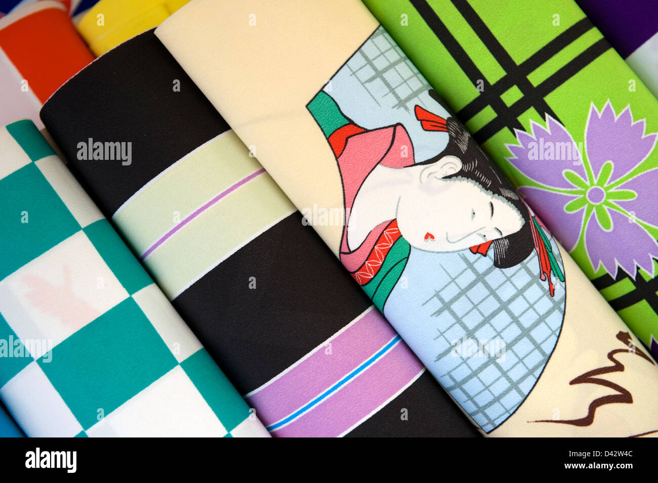 Bolts of colorful Japanese fabric, one with a Ukiyo-e style print, for sale at a retail shop in Tokyo, Japan. - Stock Image