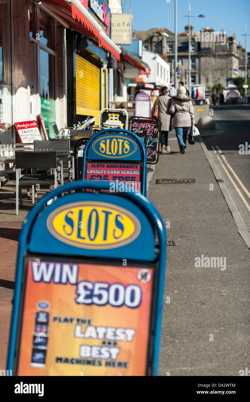 Advertising signs on the pavement in Newquay Town Centre in Cornwall, England, UK. - Stock Image