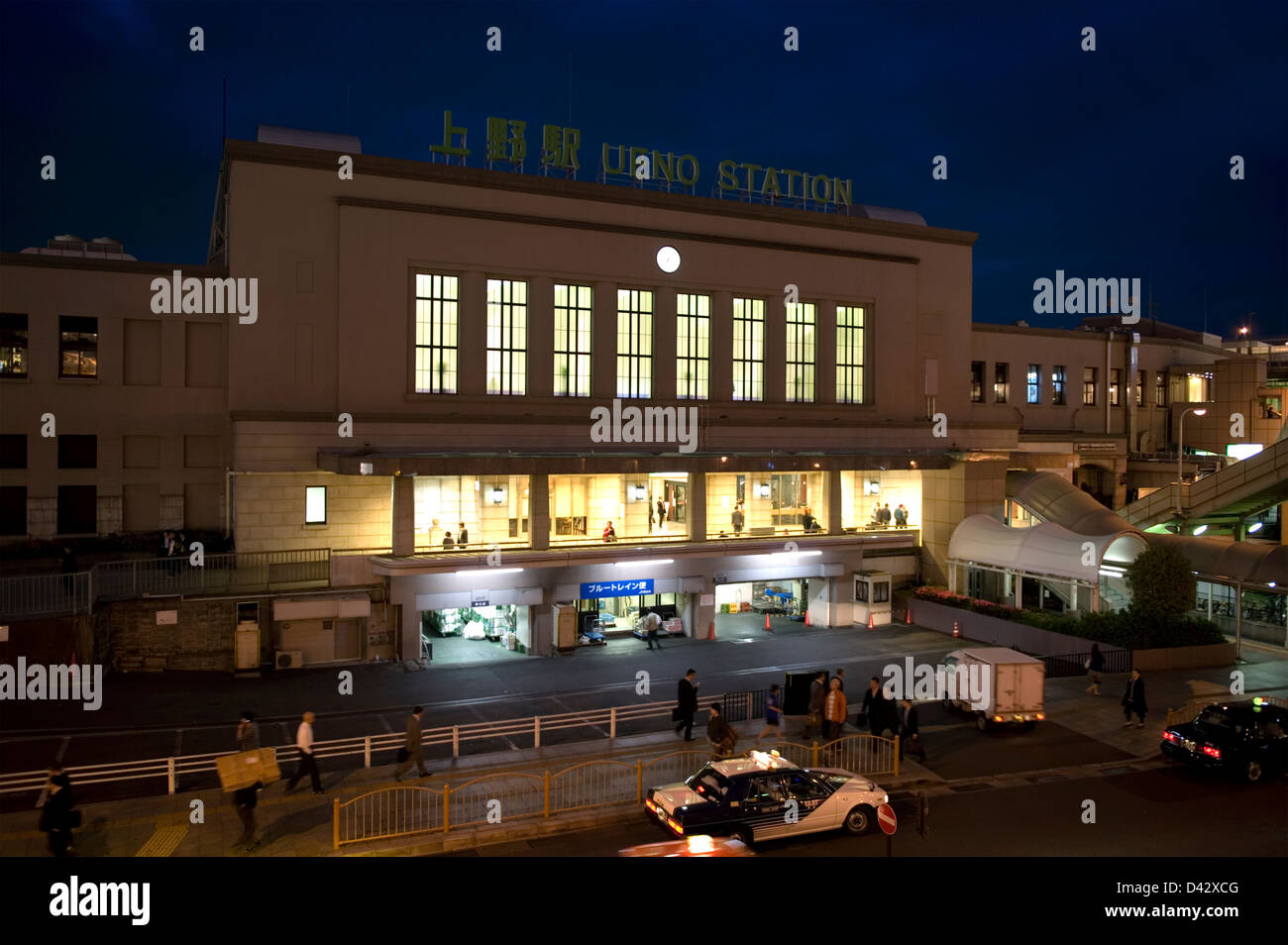 Night time view of the main facade of the Japan Railway (JR) Ueno Station in downtown Tokyo built in 1932. - Stock Image