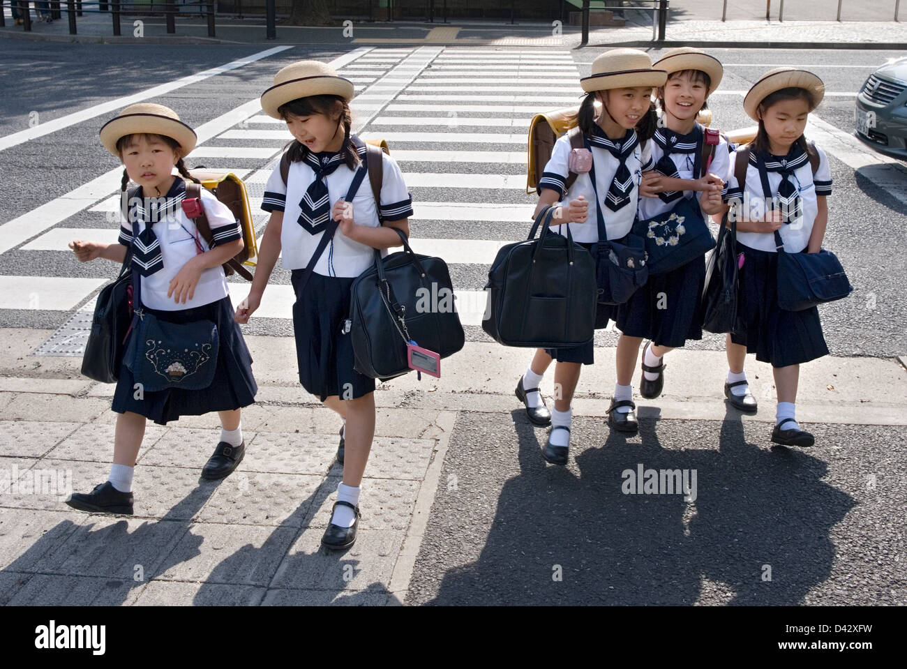 Five Elementary School Girls In Sailor Uniforms And Cute Hats