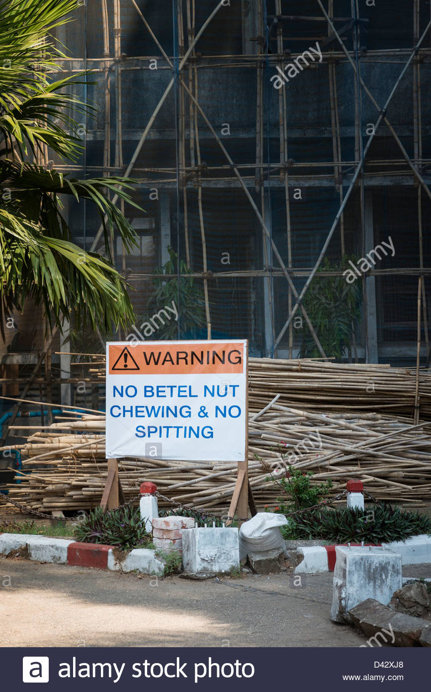 Bamboo scaffolding around a construction site in Yangon Myanmar - Stock Image