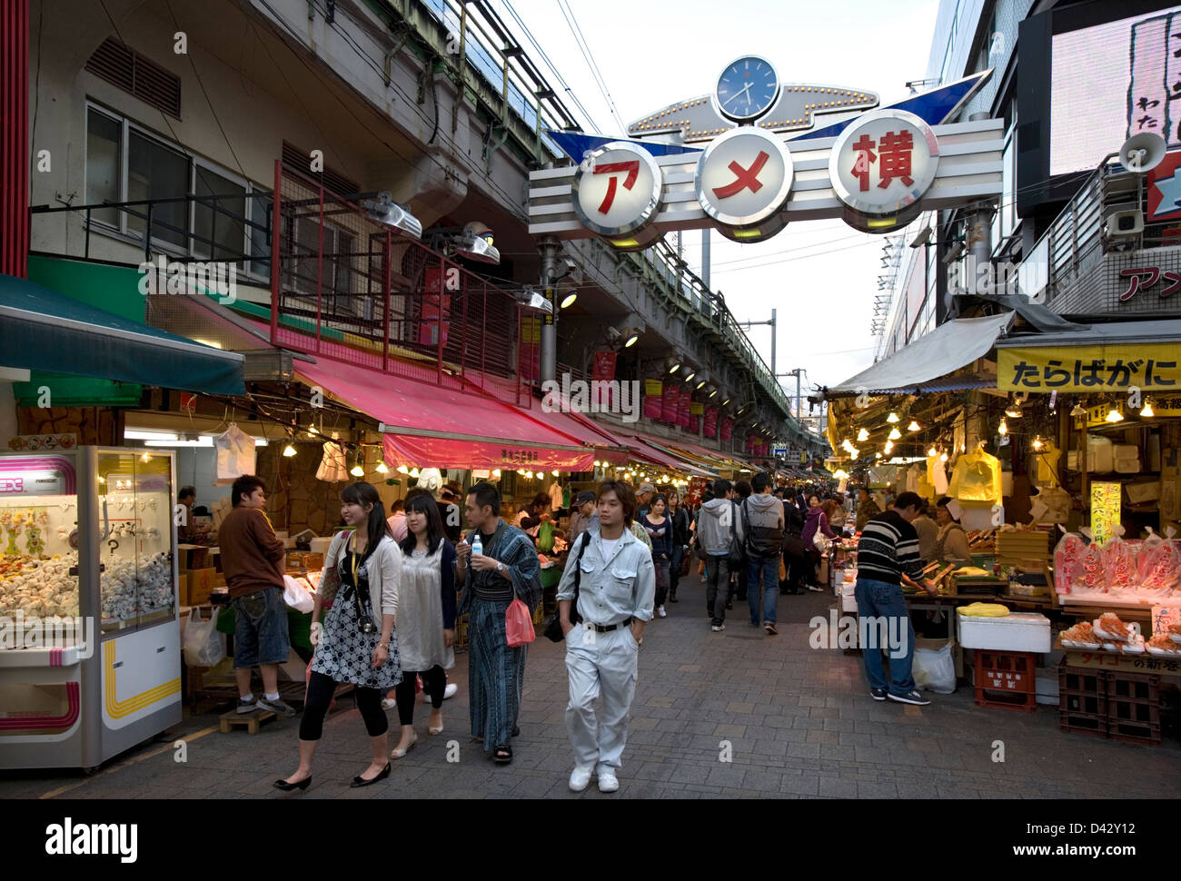 Ameyoko-cho, former black market under railway in Okachimachi Tokyo, is a thriving food and merchandise marketplace - Stock Image