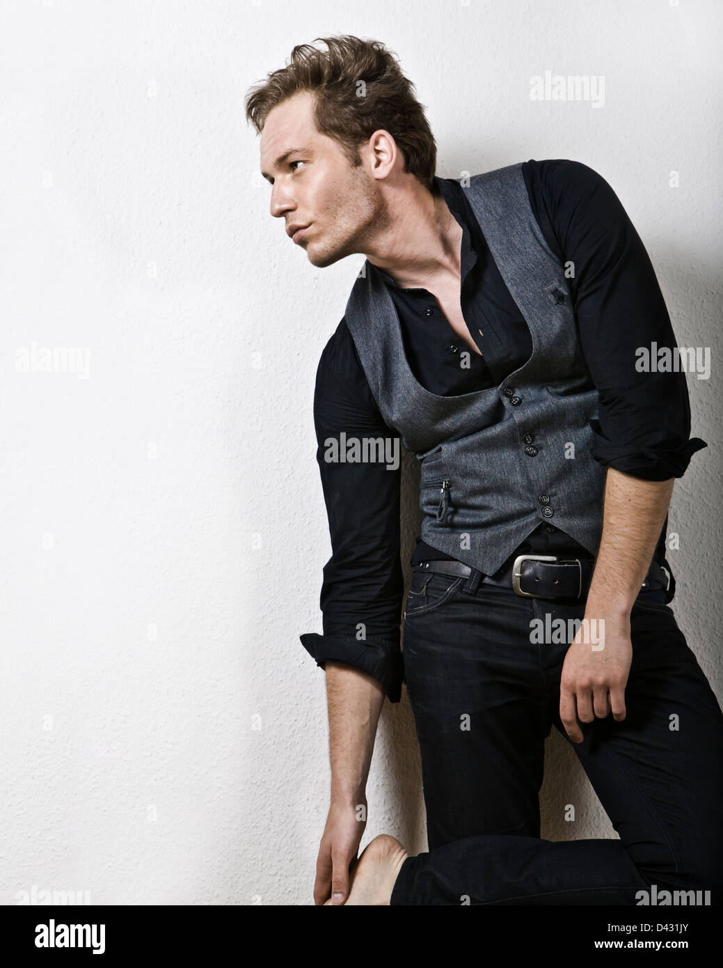 fashion shot of a male mmodel in casual clothes in black