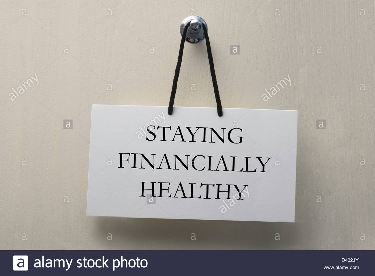 Staying financially healthy sign on door - Stock Image