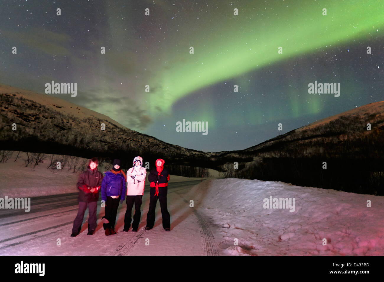 tourists watching northern lights aurora borealis near tromso in northern norway europe - Stock Image