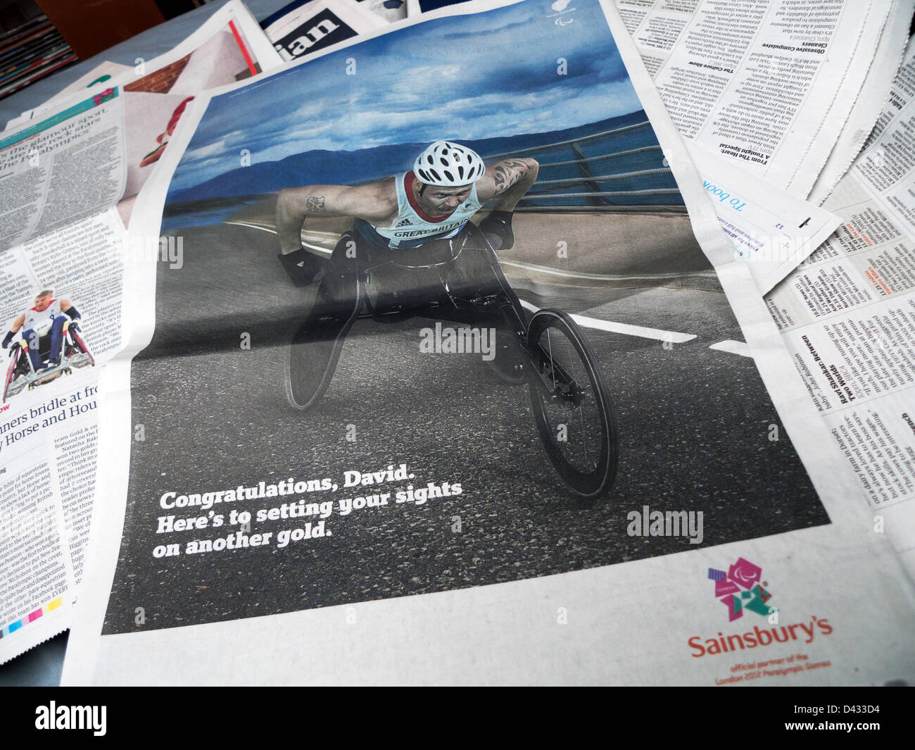 Paralympic gold medal winner David Weir and sponsor Sainsbury's advert in a broadsheet newspaper London England - Stock Image