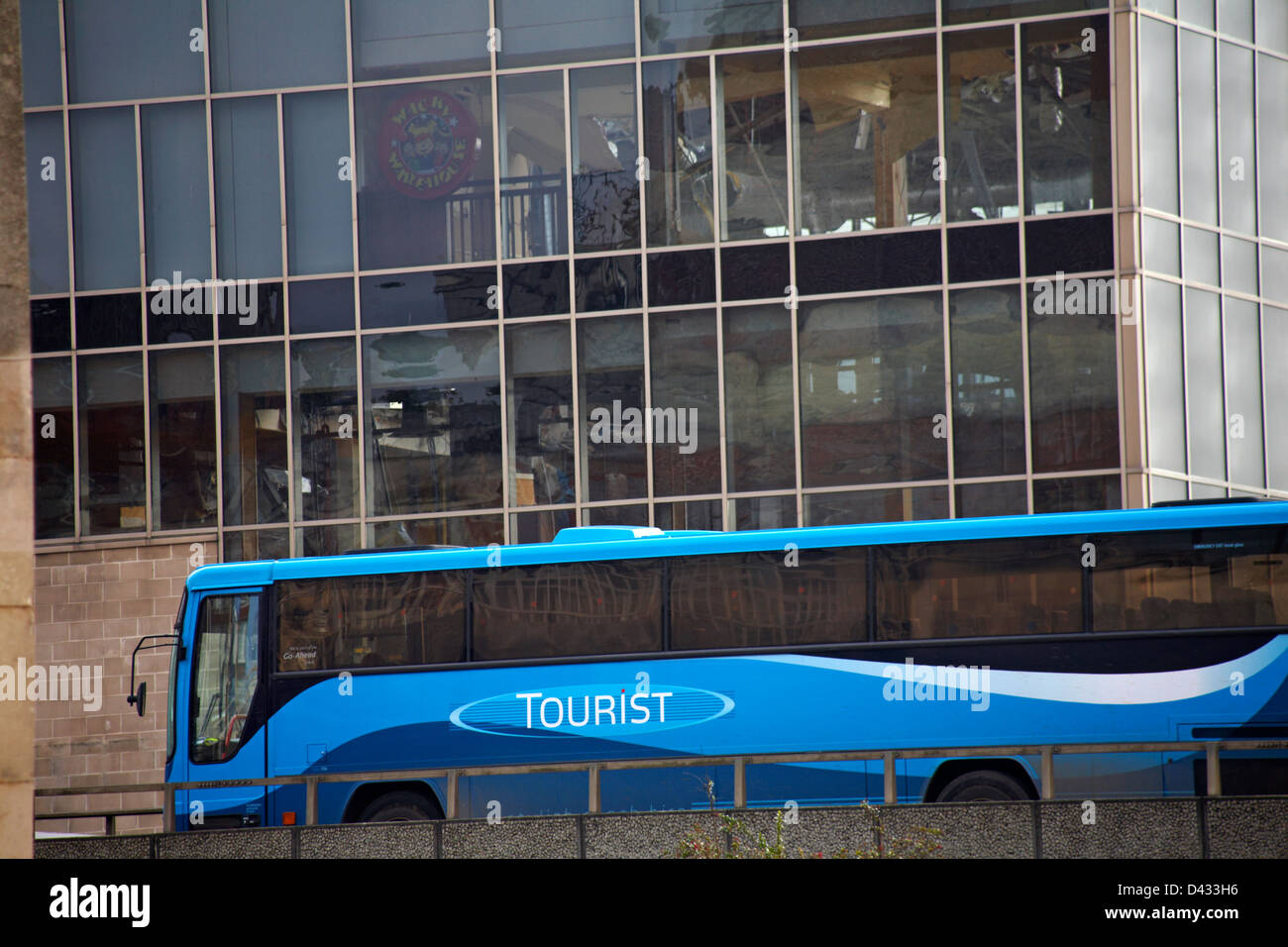 tourist coach going past Imax building currently being demolished at Bournemouth in February - Stock Image