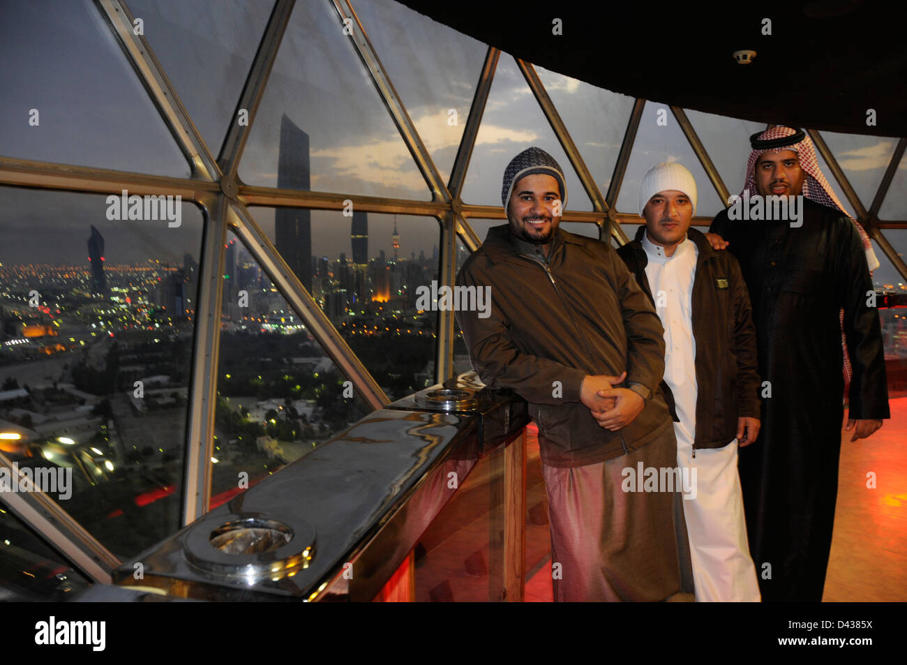 Three friends from Saudi Arabia posing for a photo in Kuwait Towers, Kuwait City - Stock Image