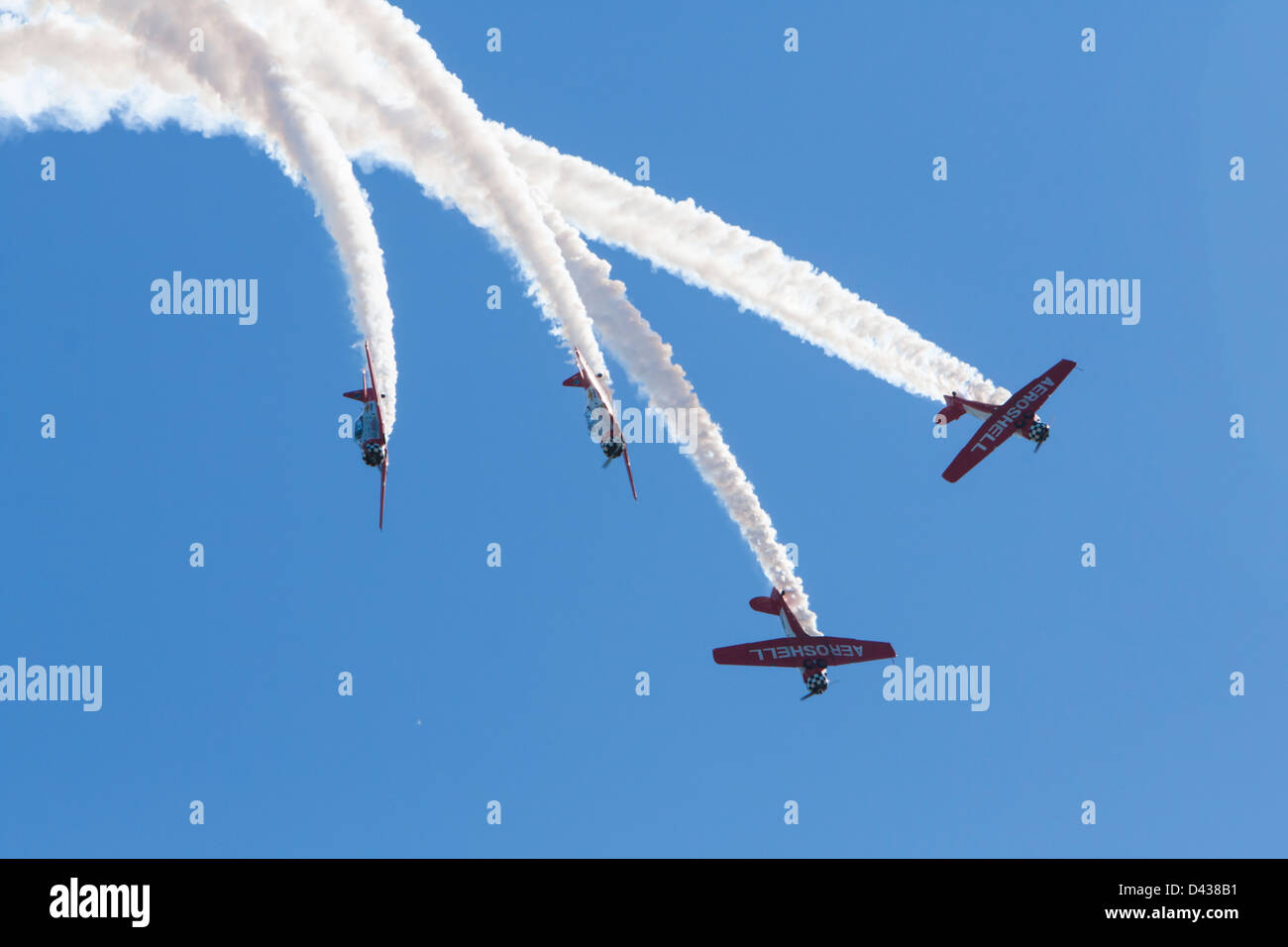 The Aeroshell aerobatic team fly in formation at the Stuart Air Show. - Stock Image
