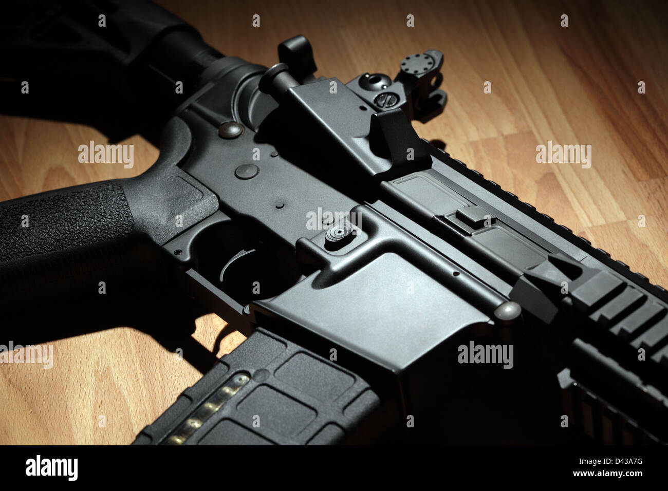 Part of AR-15 (M4A1) carbine in a light beam Stock Photo