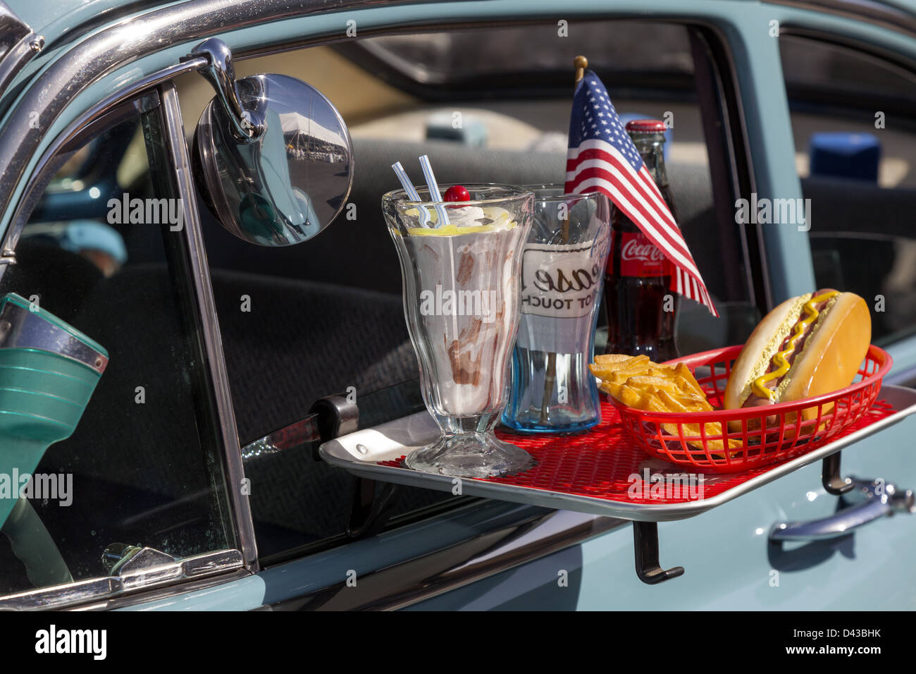 Car hop tray hung on the window of a classic car closeup - Stock Image