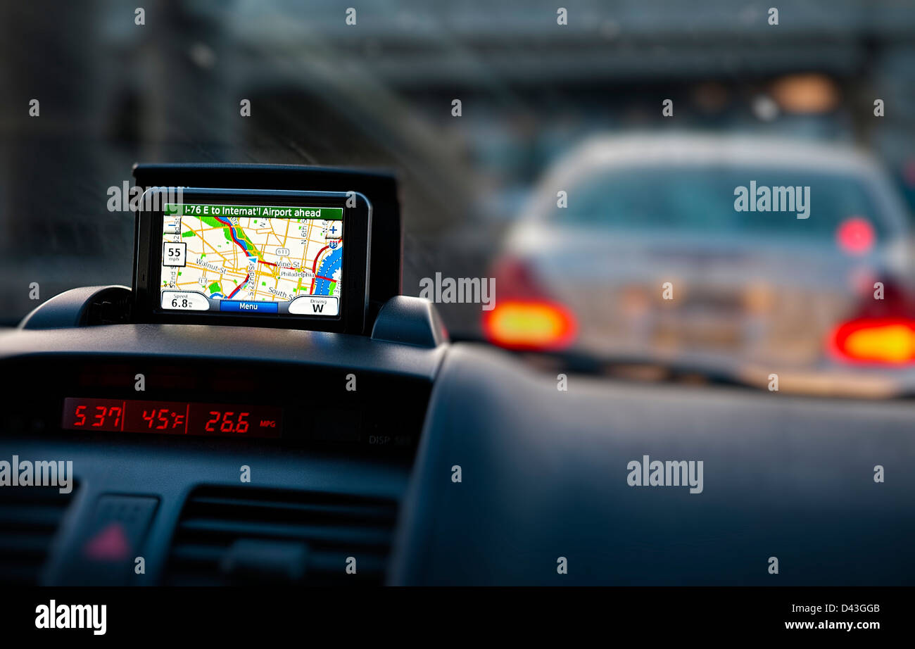 GPS unit on the dashboard of a car. - Stock Image