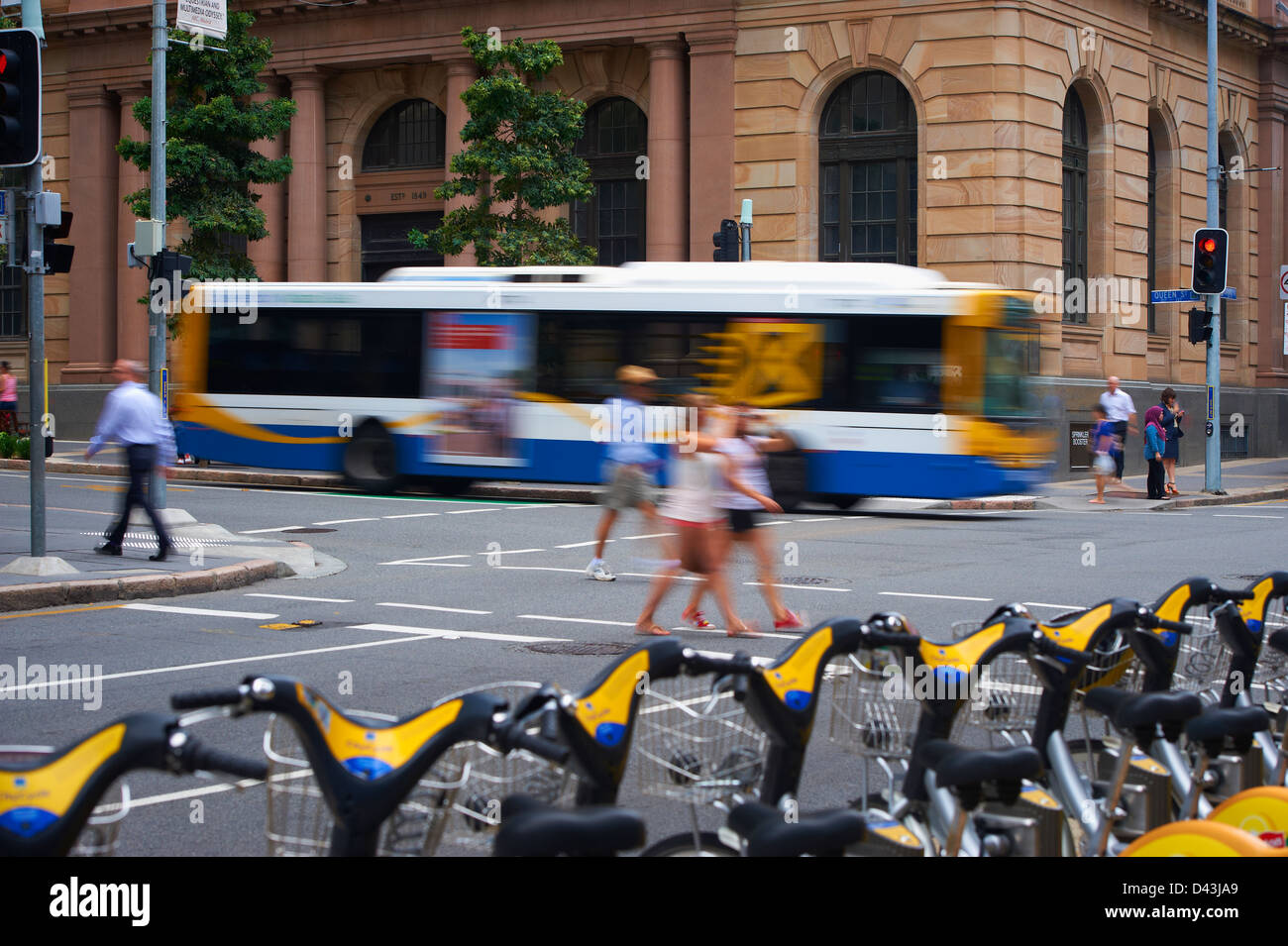 Brisbane City Council Bus in the city and pedestrians Stock Photo
