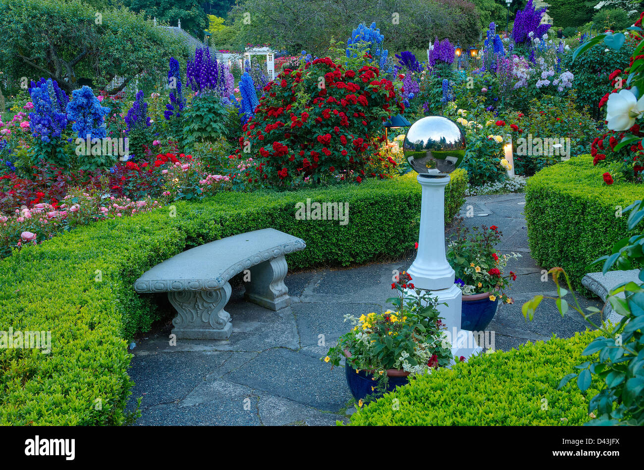 Metal orb in the Rose Garden, Butchart Gardens, Brentwood Bay, Vancouver Island, British Columbia, Canada - Stock Image