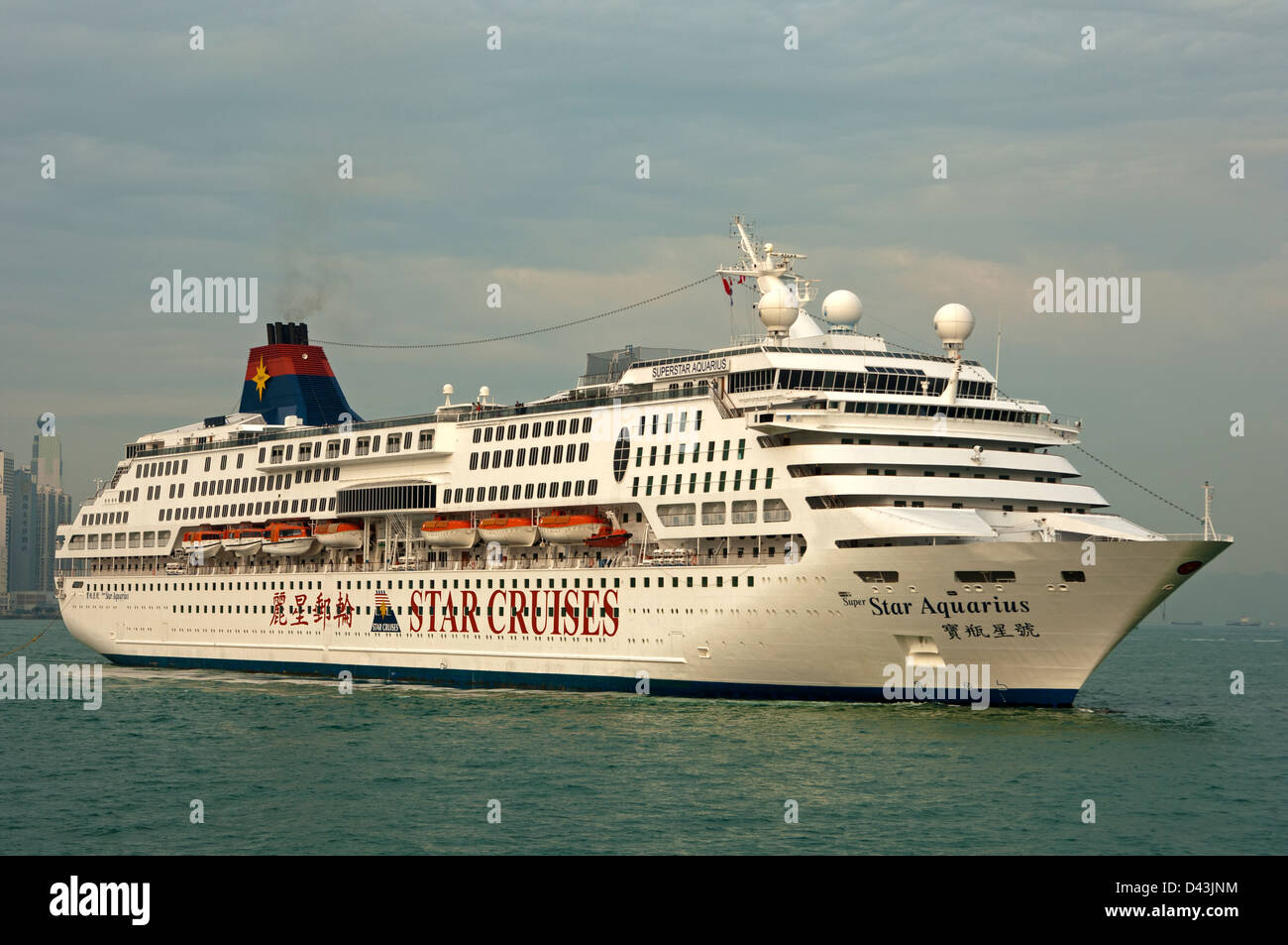 Cruise liner SuperStar Aquarius in the Victoria Harbour of Hong Kong - Stock Image