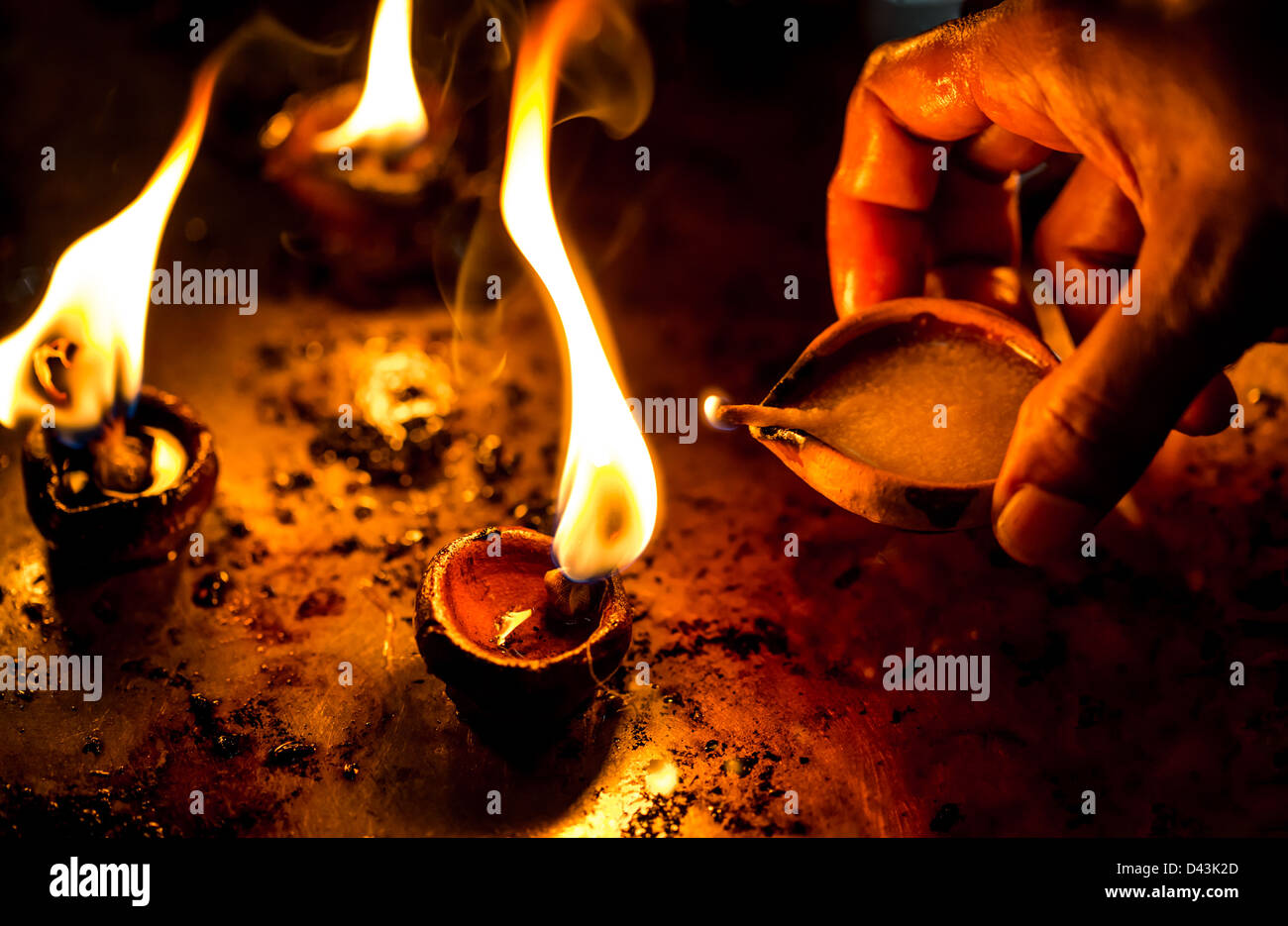 Burning candles in the Indian temple. Diwali – the festival of lights. - Stock Image