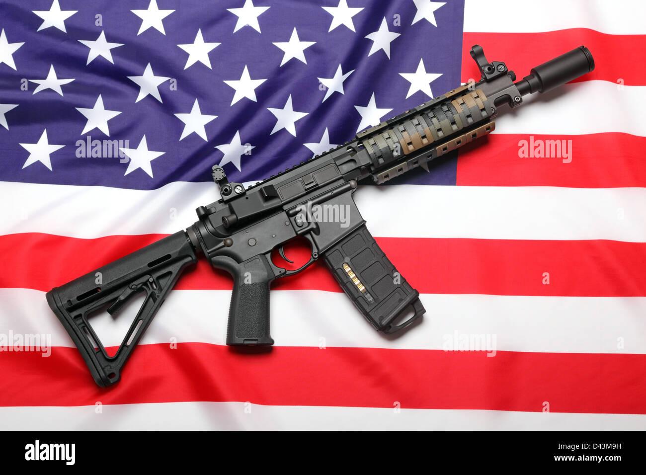 AR-15 (M4A1) custom carbine on the flag of USA - Stock Image