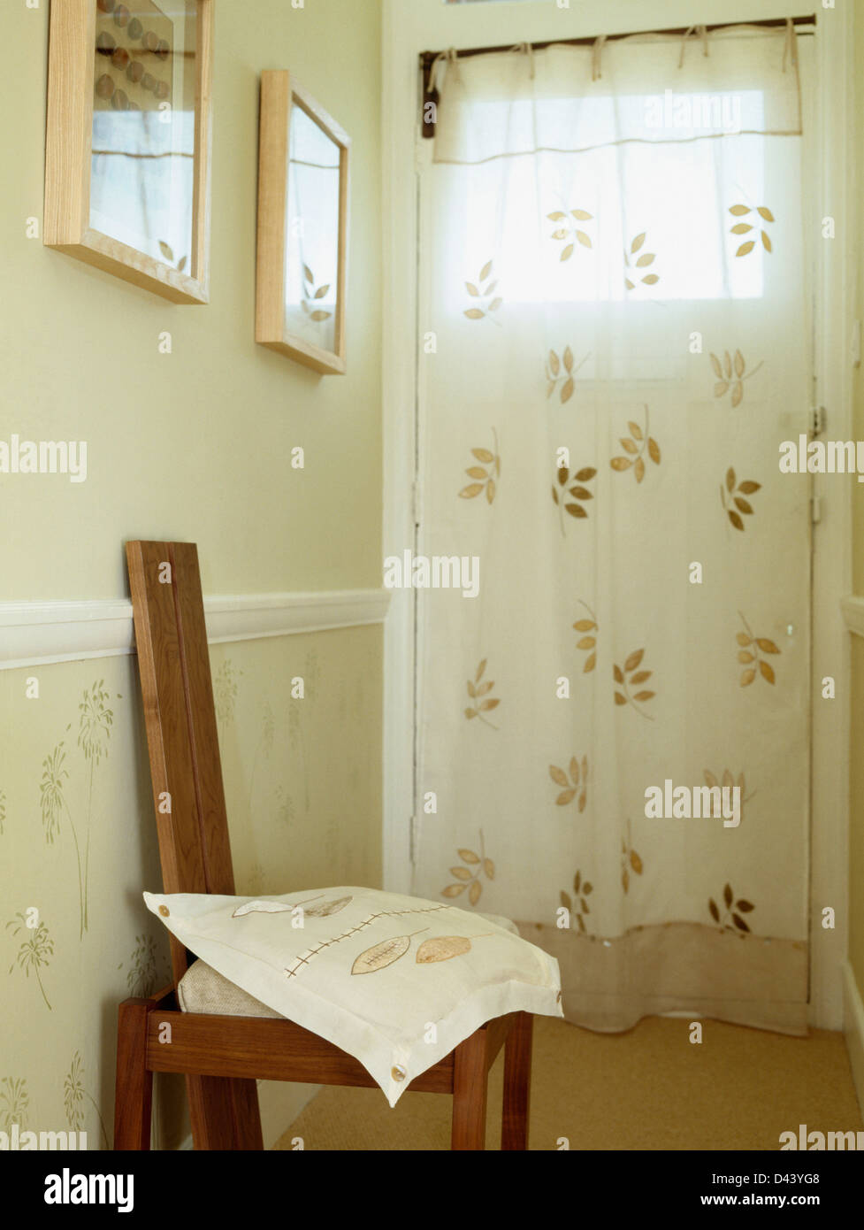 Appliqued Cream Voile Curtain On Front Door In Hall With Appliqued Cushion  On Wooden Chair Against Wall With Stenciled Dado