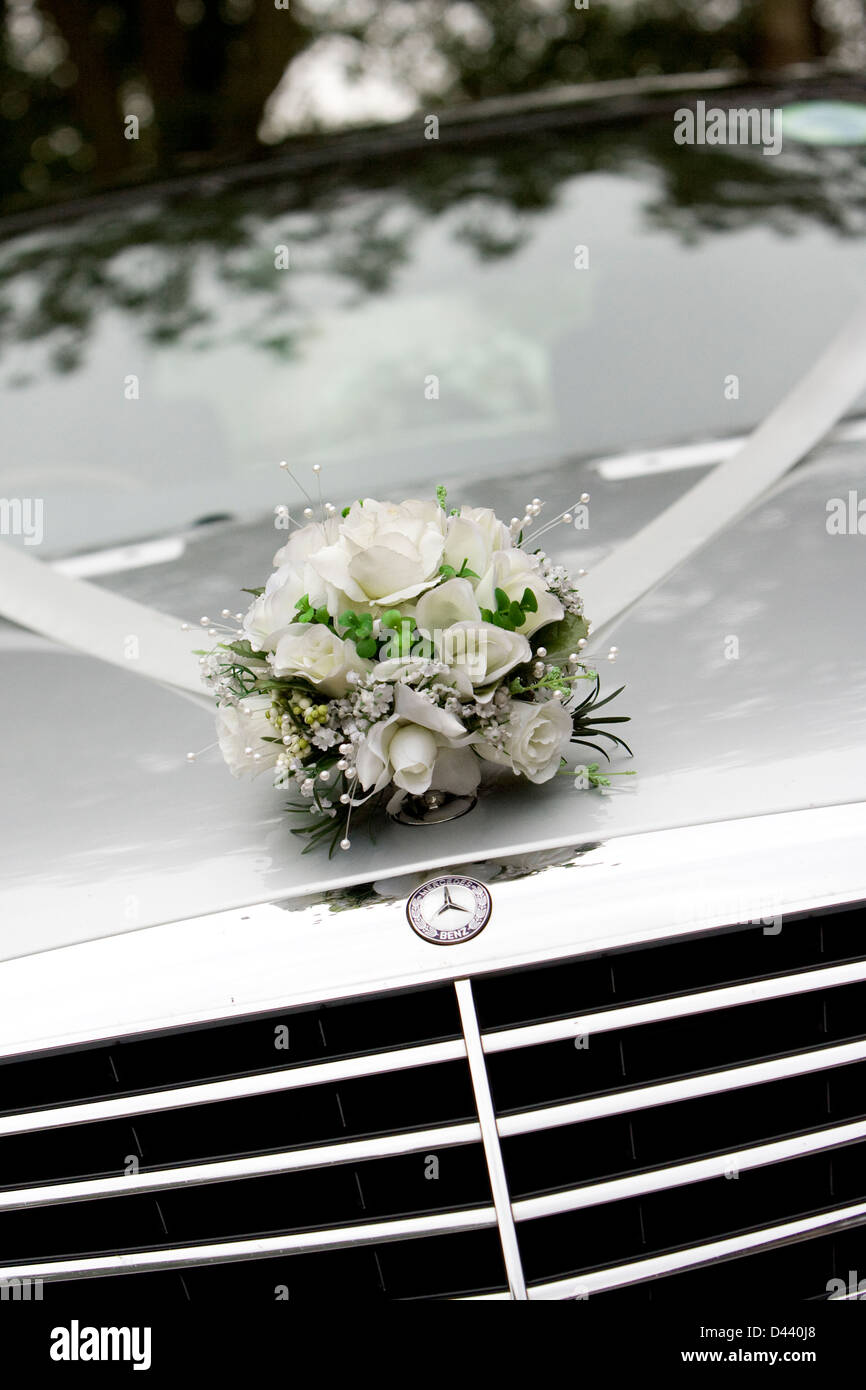 Floral wedding decoration in white, silver and green fixed to front ...